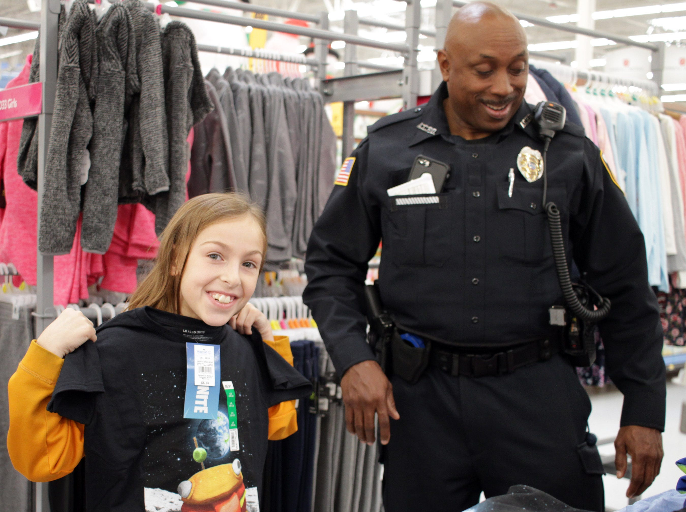 Taylor Humphrey (9) shops with Officer Steven Ellis at Shop with a Cop in Ashland City on Saturday, December 15, 2018.
