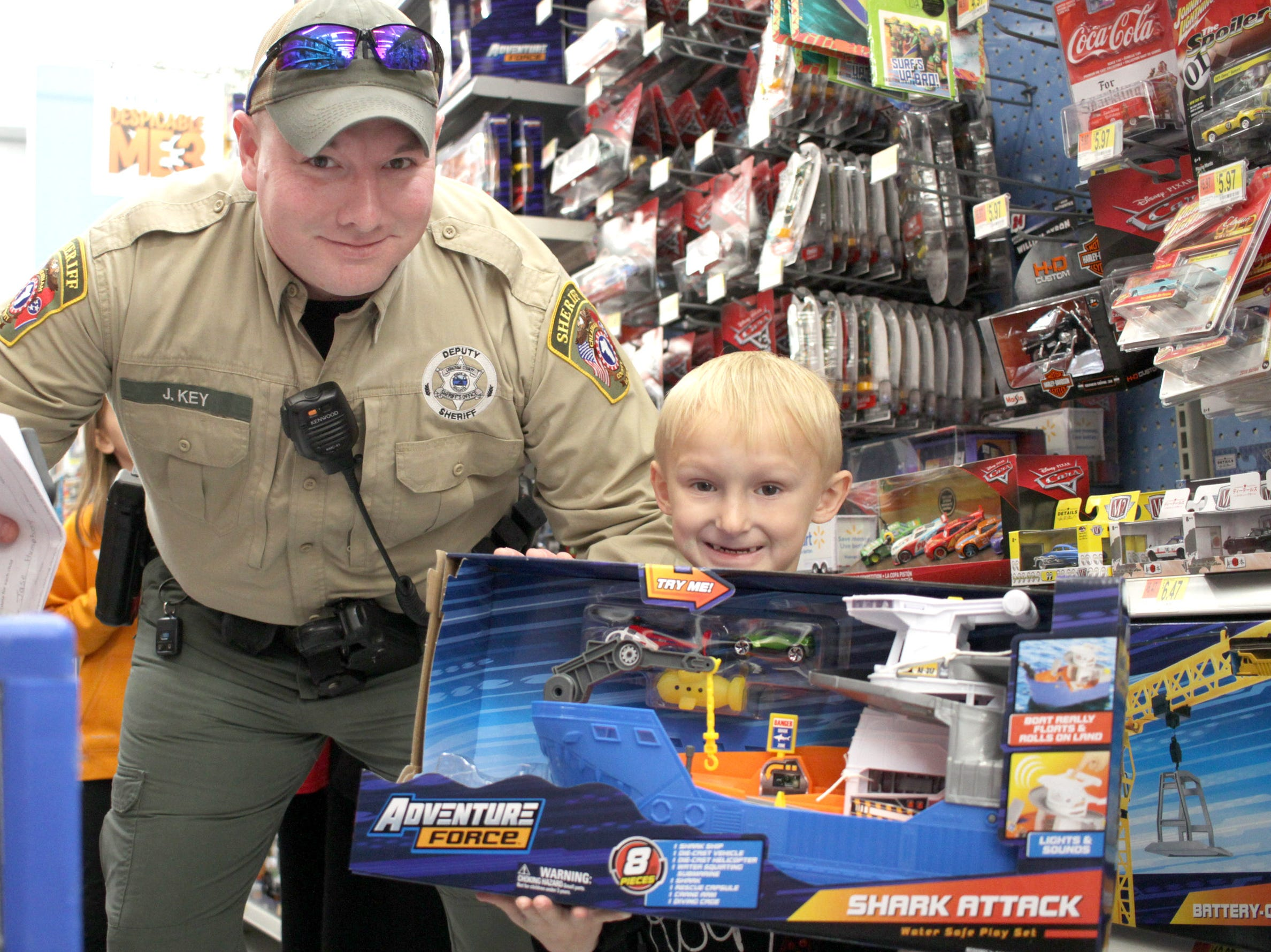 Officer Jeff Key shops with Jase Humphrey (5) during Shop with a Cop in Ashland City, TN on Saturday, December 15, 2018.