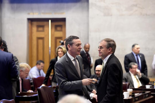 Rep. Glen Casada, left, talks to Rep. Bill Dunn in the House chambers at the state Capitol on Feb. 11, 2016.