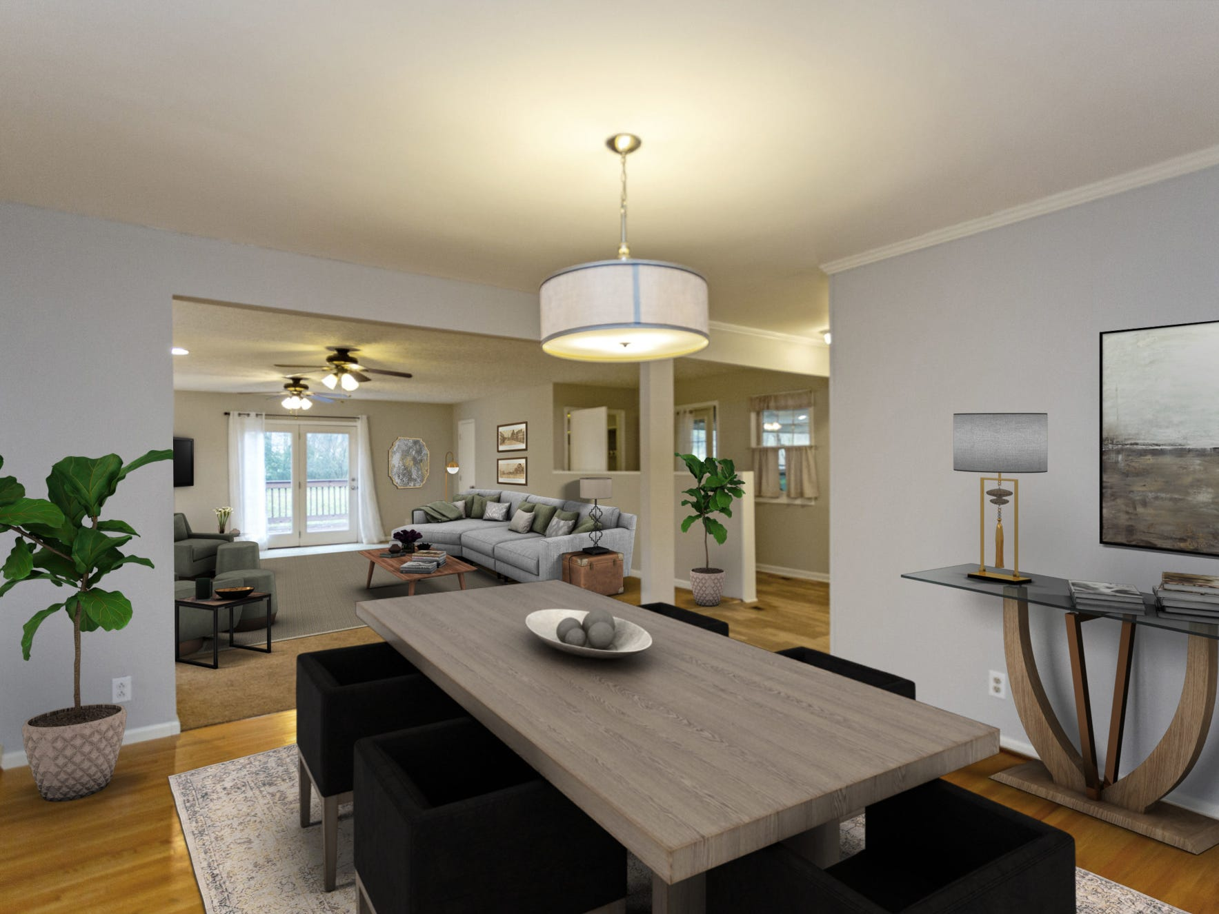 This photo shows the home's dining and living space after virtual staging software was used to furnish the room. This gives home buyers a look at the room with furnishings in it.