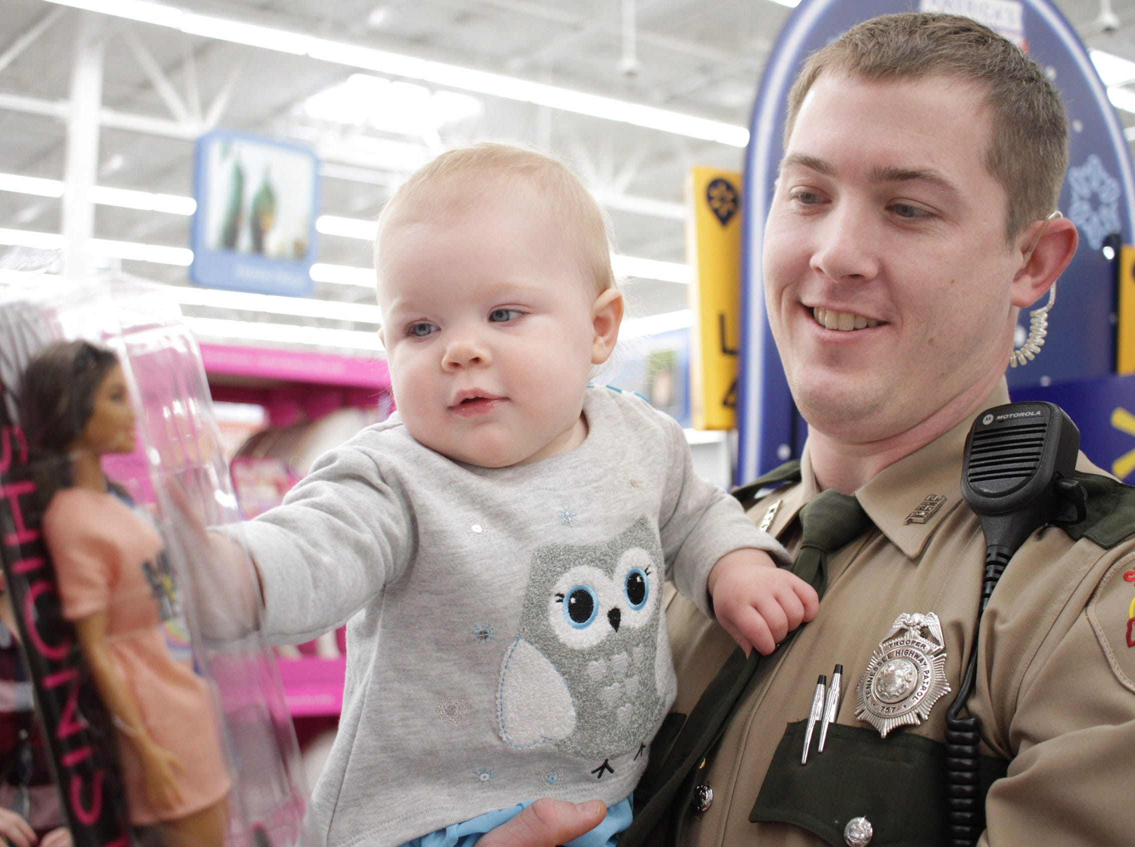 Trooper Cory Brock shops with his daughter Avery (13 Months) at Shop with a Cop in Ashland City on Saturday, December 15, 2018.