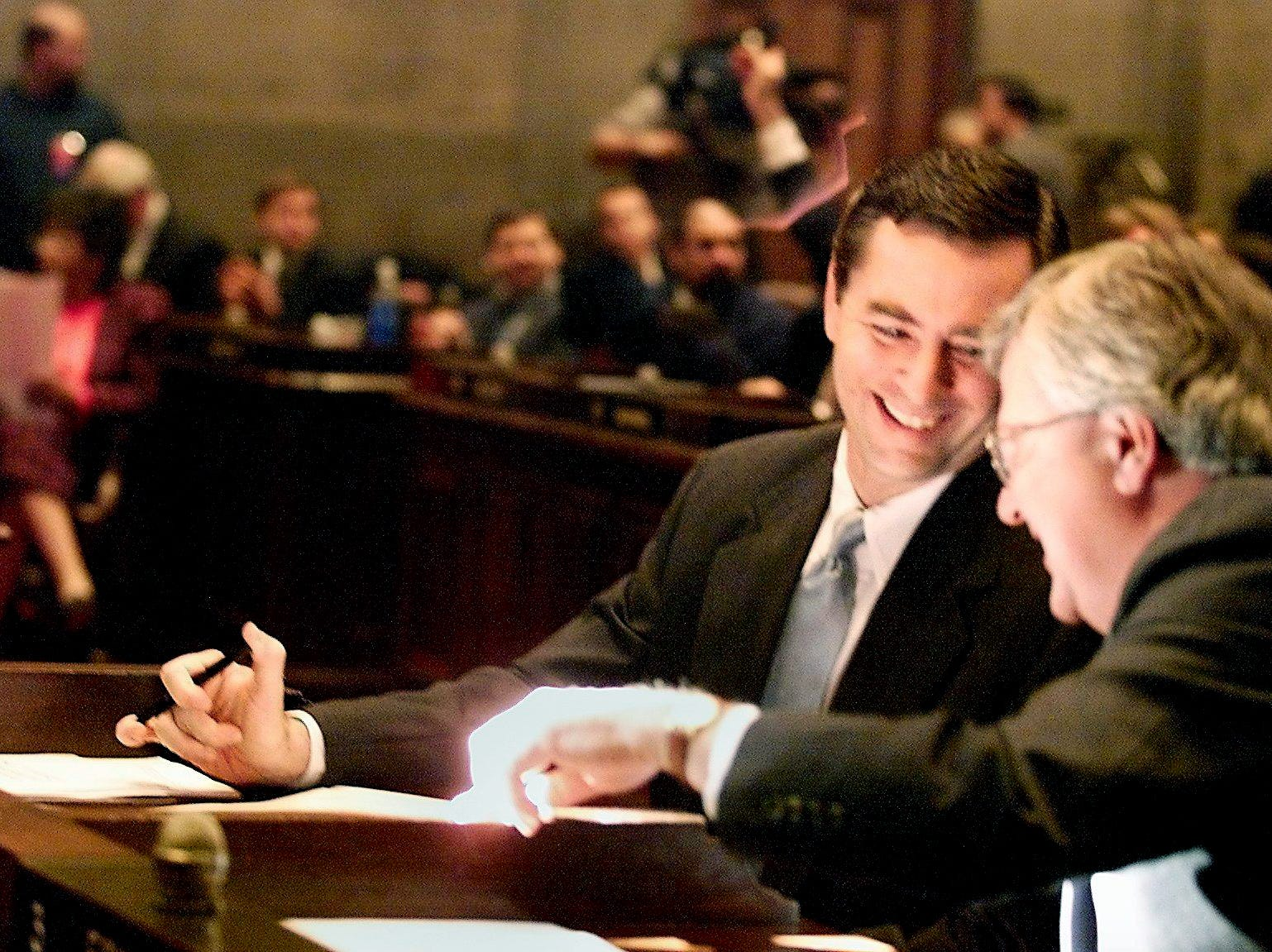 Newly sworn in, Glen Casada (R) chats with his state House of Representatives colleague Joe Fowlkes on Jan. 8, 2002.