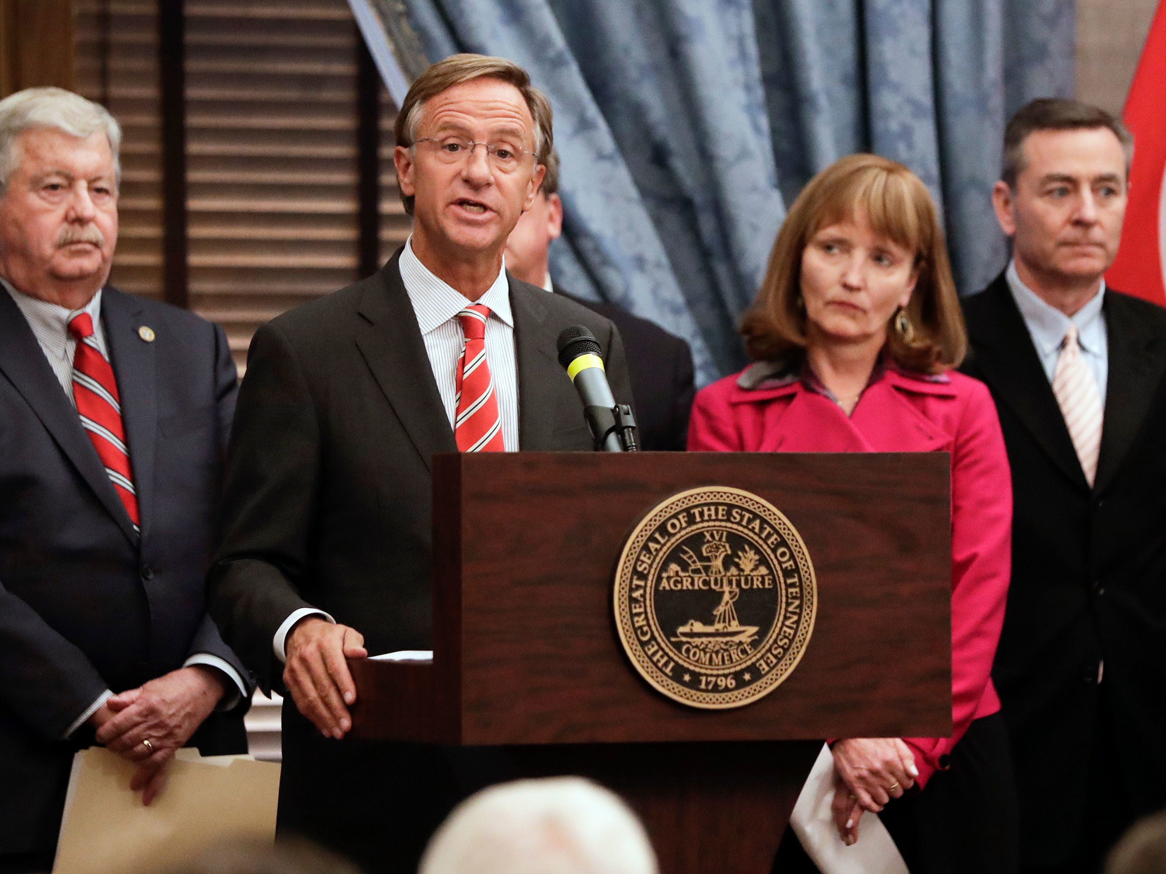 Tennessee Gov. Bill Haslam announces a joint state plan to address the opioid crisis Jan. 22, 2018, in Nashville. Looking on are Senate Speaker Randy McNally, left, R-Oak Ridge; House Speaker Beth Harwell, R-Nashville; and Rep. Glen Casada, R-Franklin.
