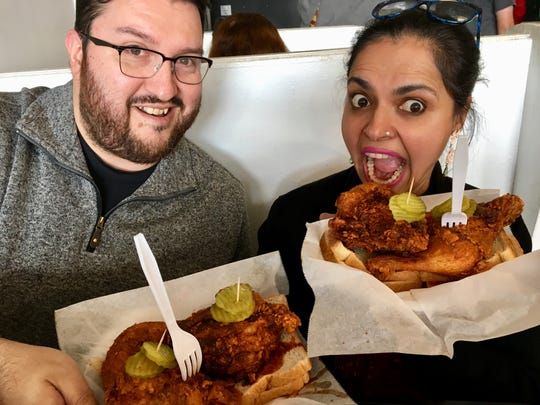 Celebrity chef Maneet Chauhan and Tennessean chicken taster Juan Buitrago show off their hot chicken plates at Prince's Hot Chicken Shack.