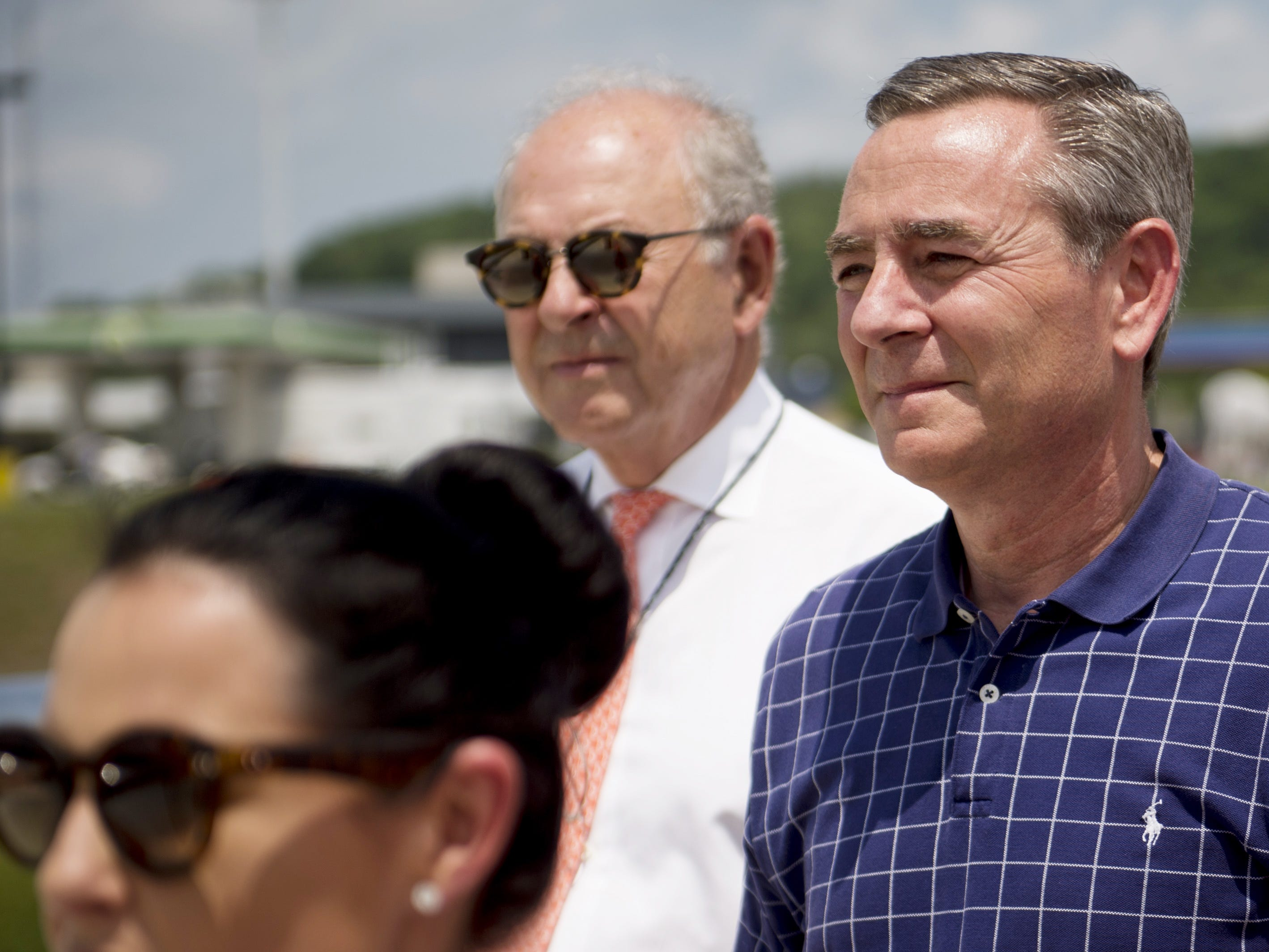 Rep. Glen Casada, right, looks on during the ribbon-cutting ceremony for the Peytonsville Road bridge over Interstate 65 on June 15, 2016, in Franklin.