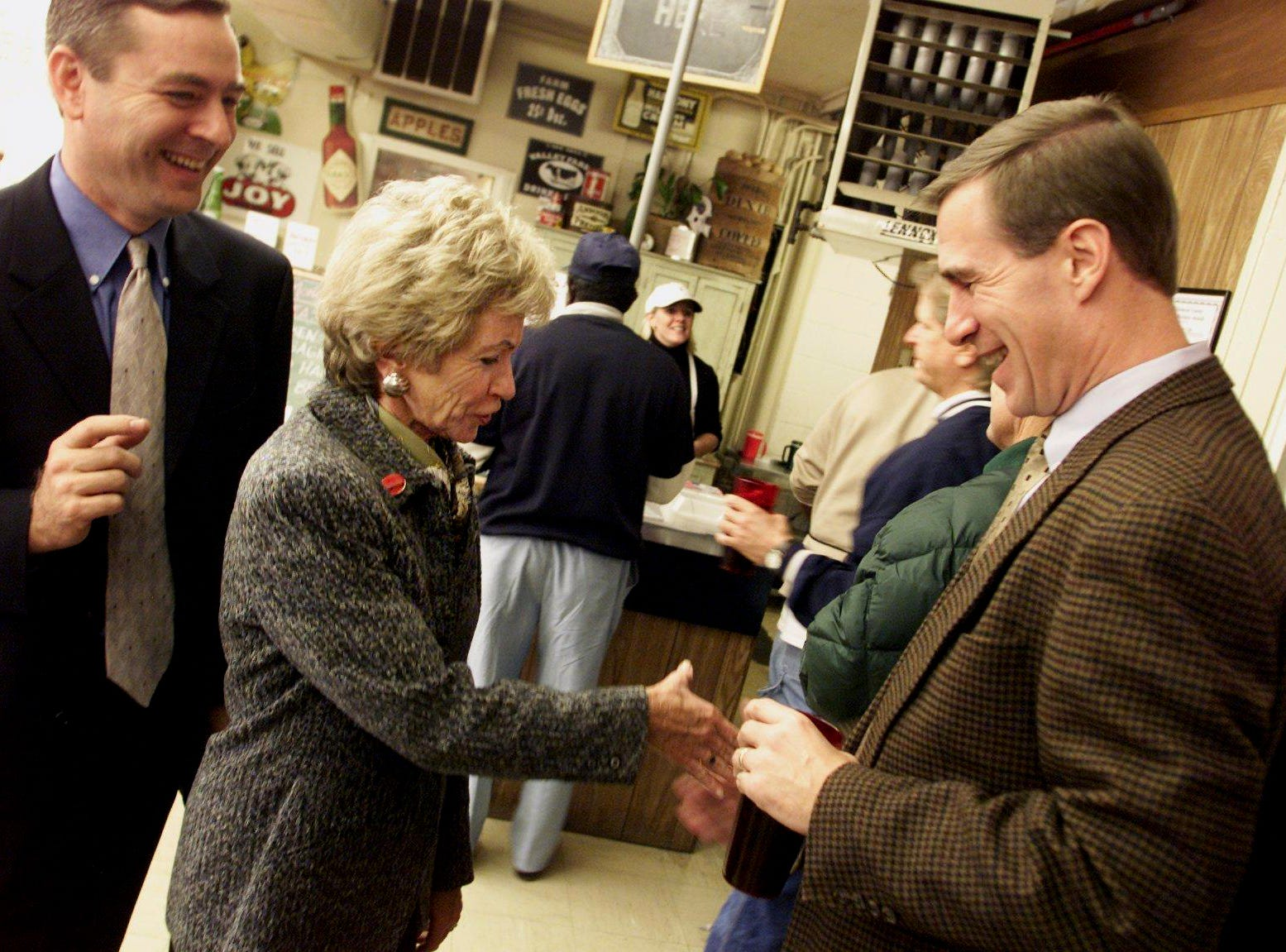 Honey Alexander, center, wife of U.S. Senate candidate Lamar Alexander, greets patrons in line at One Stop Cafe in downtown Franklin on Nov. 4, 2002, including state Senate candidate Jim Bryson, right. Looking on is state House representative Glen Casada, left.