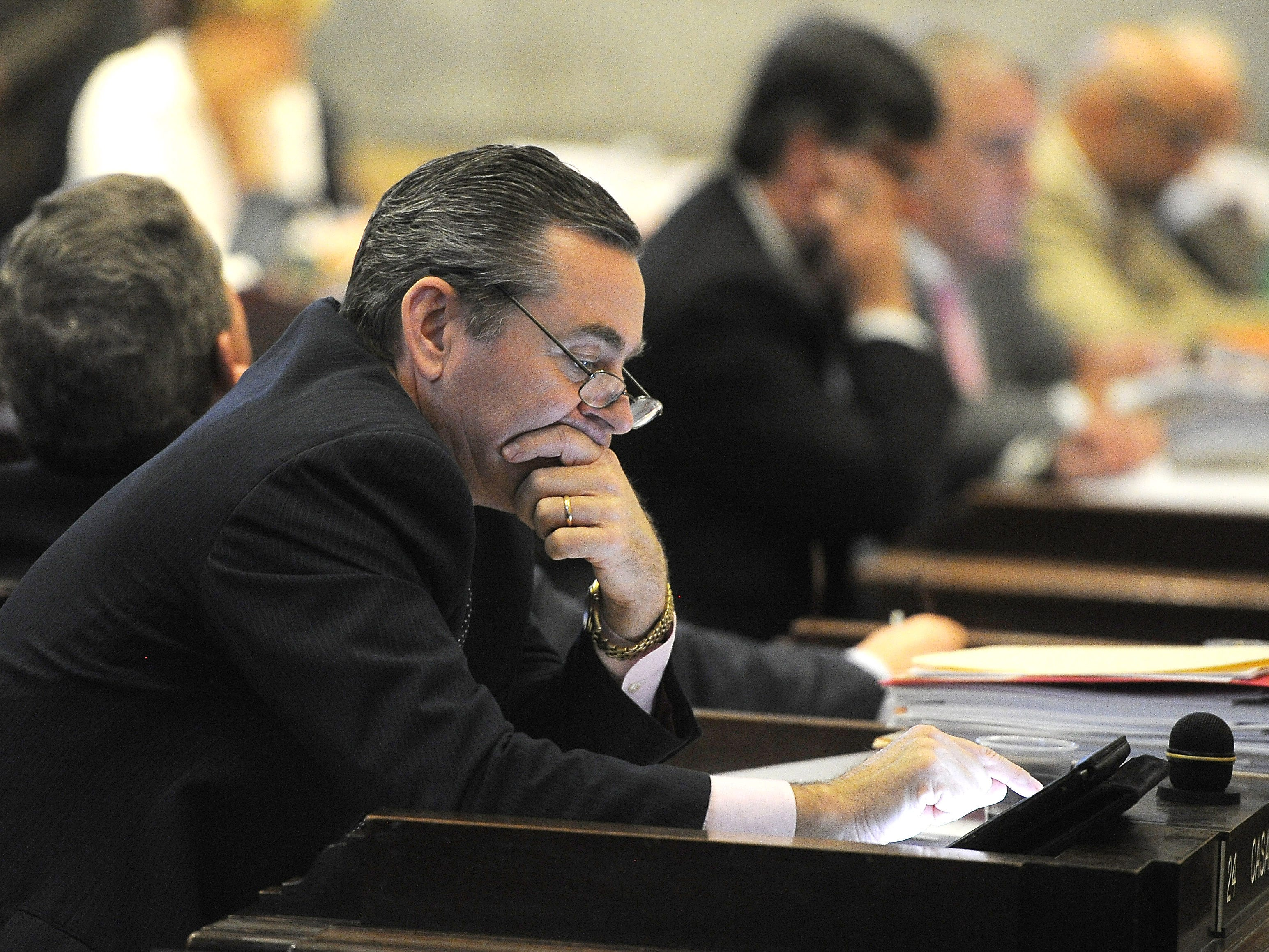 Rep. Glen Casada checks his tablet as Tennessee lawmakers are poised to vote on a $32 billion spending plan for the budget year April 10, 2014.
