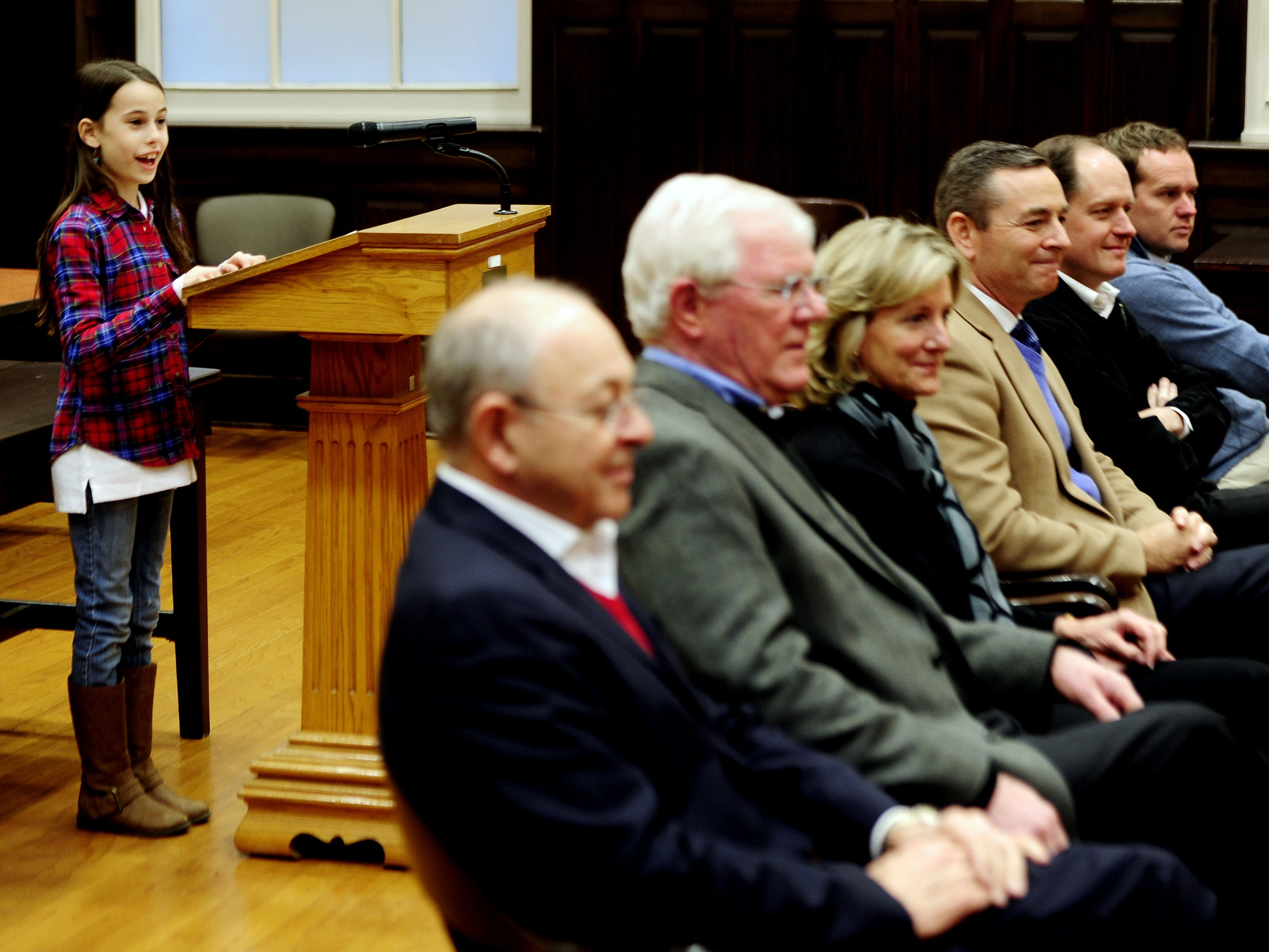 """Freedom Intermediate sixth-grader Katie Milazo, left, conducts her town """"small"""" meeting with Mayor Ken Moore, left, Rep. Charles Sargent, Judge Sharon Guffee, Rep. Glen Casada, Sen. Jack Johnson and Rep. Jeremy Durham on Dec. 15, 2013."""