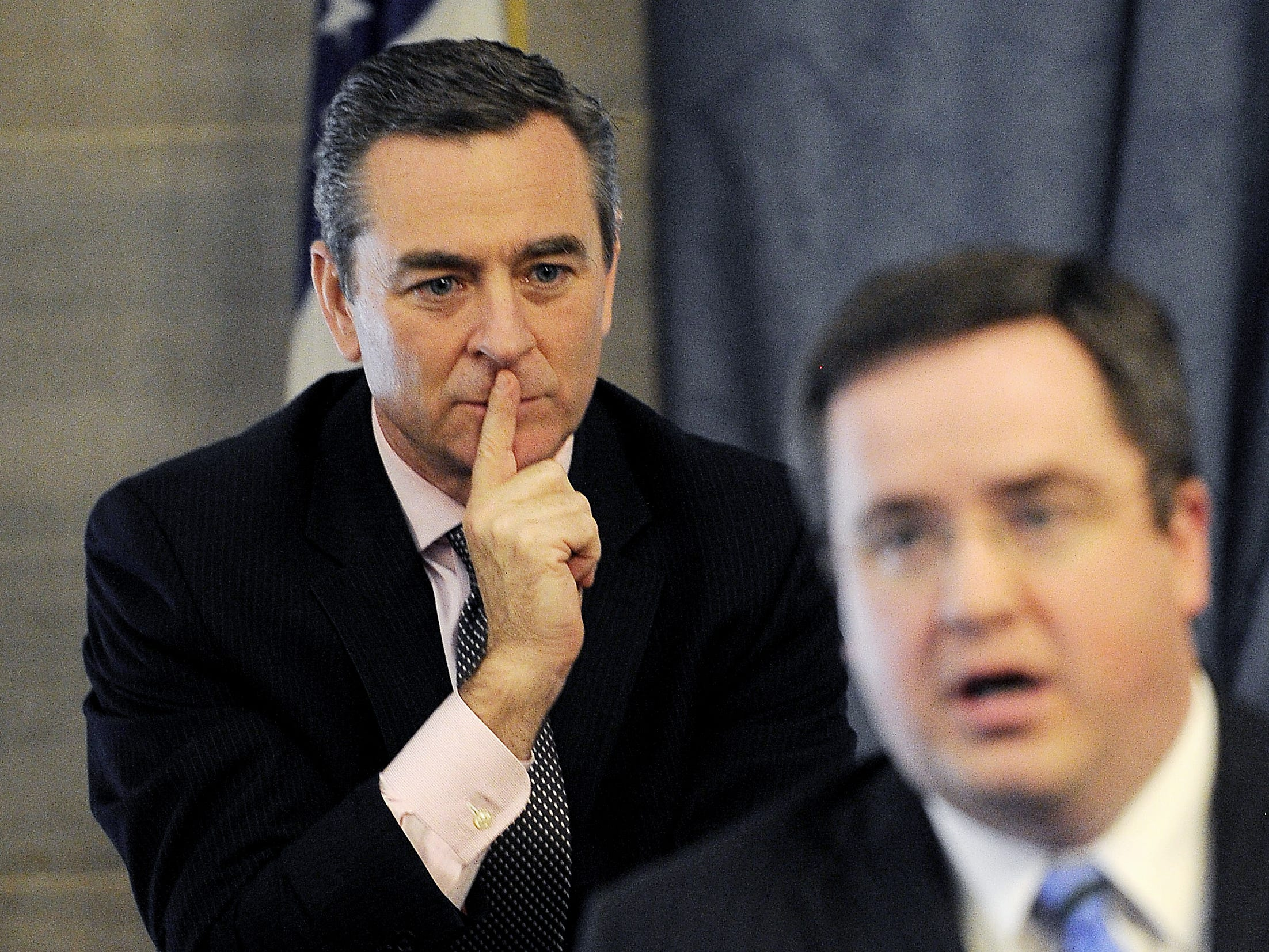 Rep. Glen Casada, back, listens as Rep. Matthew Hill talks during a caucus about an amendment to the budget bill that would pay state workers a bonus and a small raise April 10, 2014.