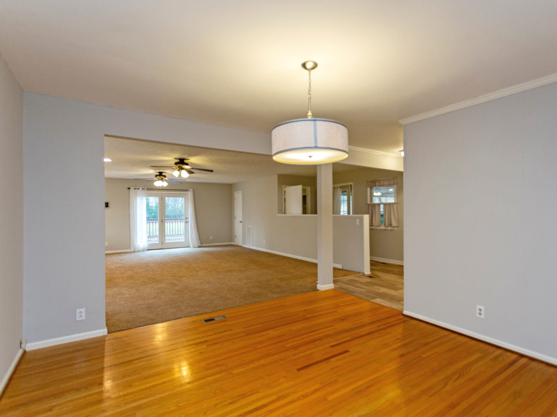 The dining and living space in the home for sale at 3038 Wilson Pike is empty, which can make it hard for potential home buyers to see how it would look furnished.