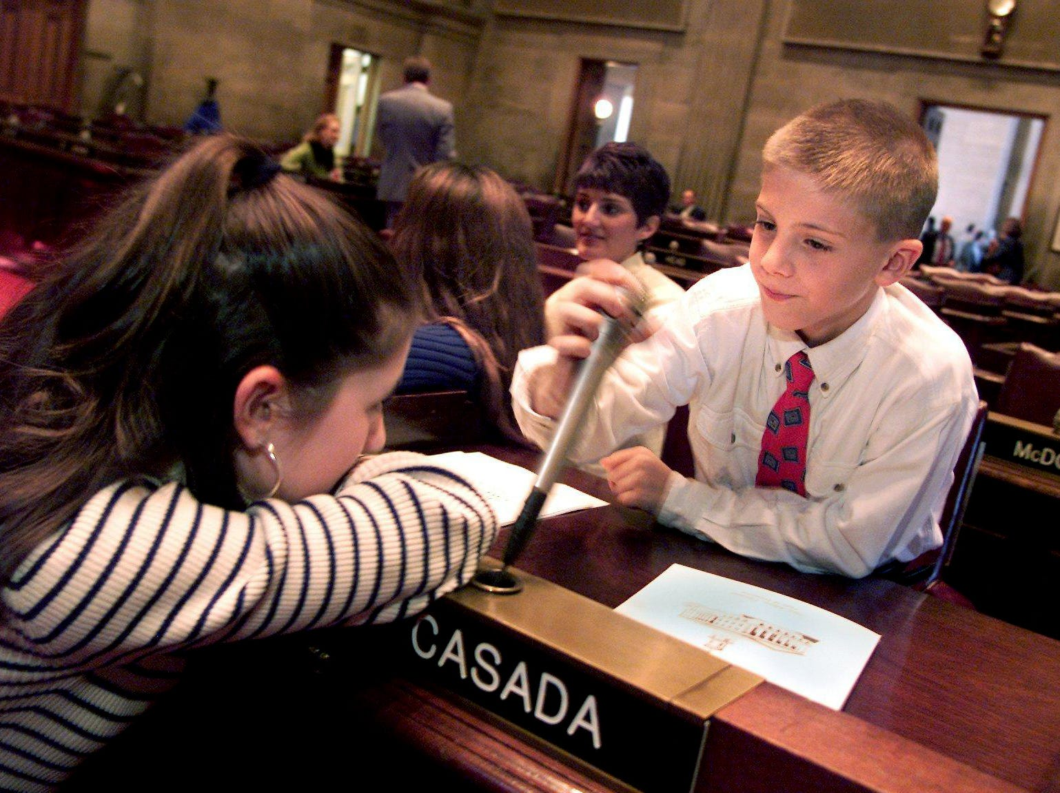 Emmaleigh Casada, 12, and her brother Clark, 10, check out their dad's new seat at the state House of Representatives before Glen Casada's swearing-in at noon Jan. 8, 2002.