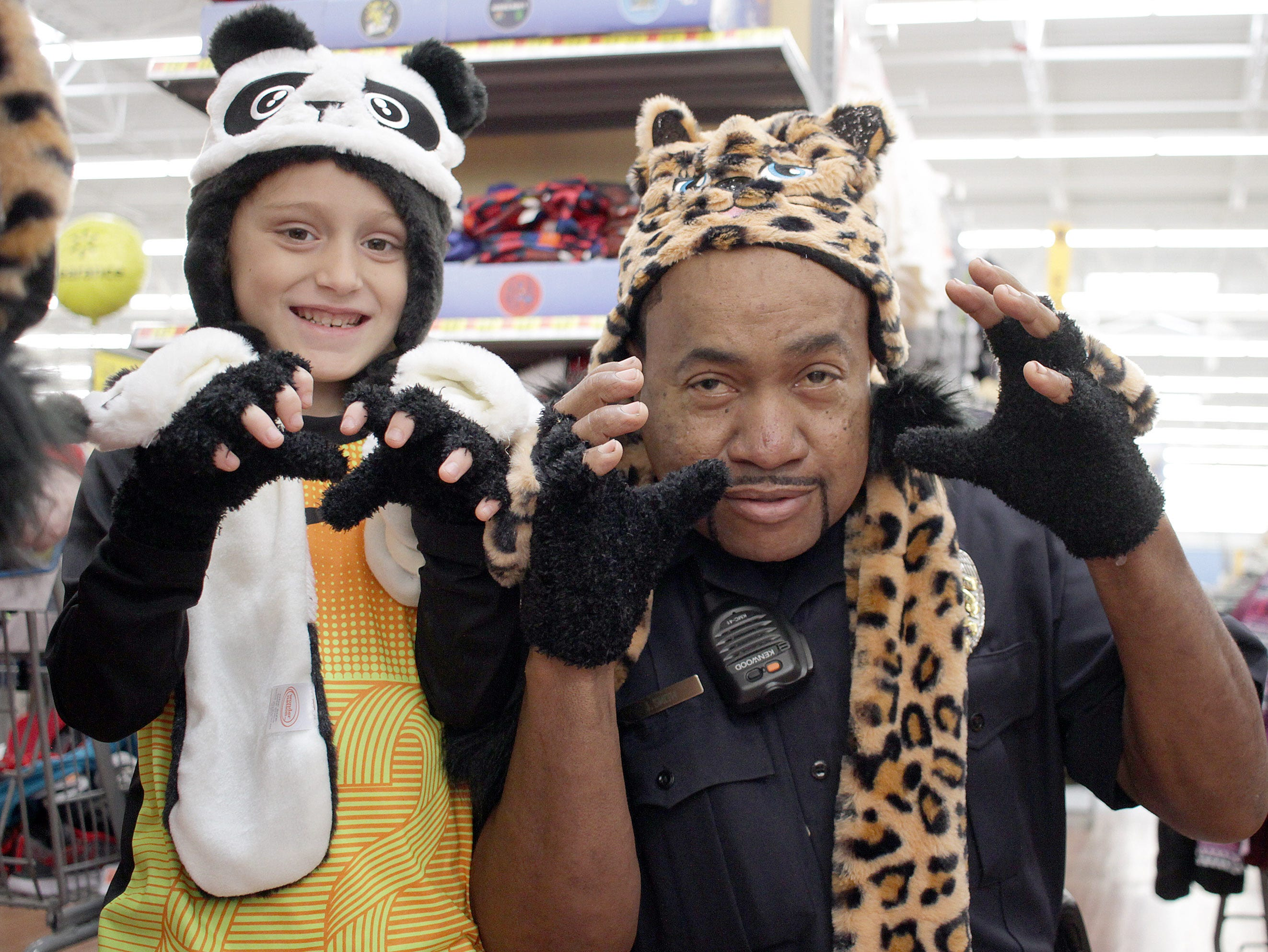 Richard Allens and Officer JT Smith show their claws during Shop with a Cop in Ashland City on Saturday, December 15, 2018.