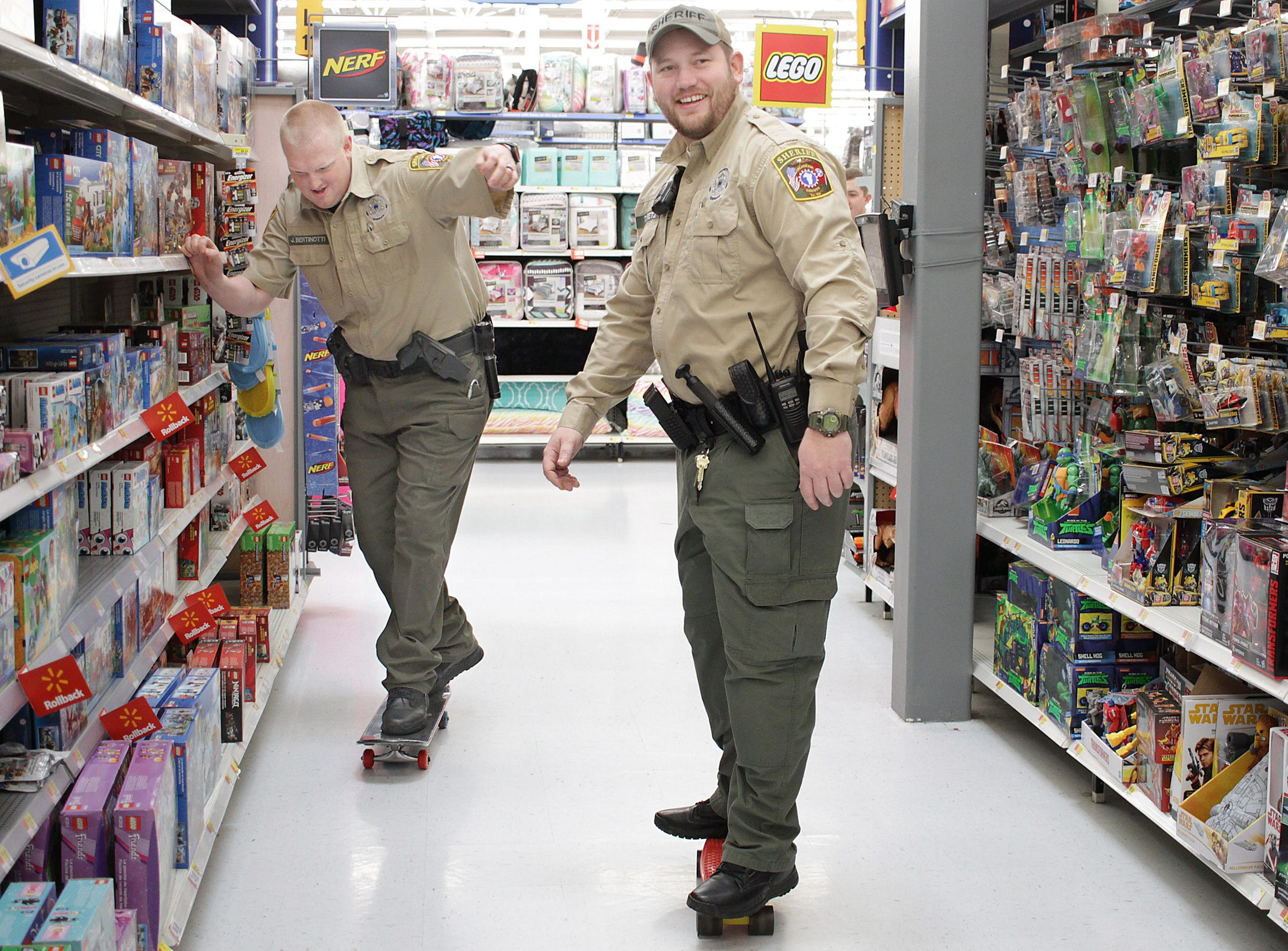 L-R Officers Travis Kretz and James Bertinotti are part of Cheatham County's Skateboard force as they show their skills during Shop with a Cop in Ashland City on Saturday, December 15, 2018.