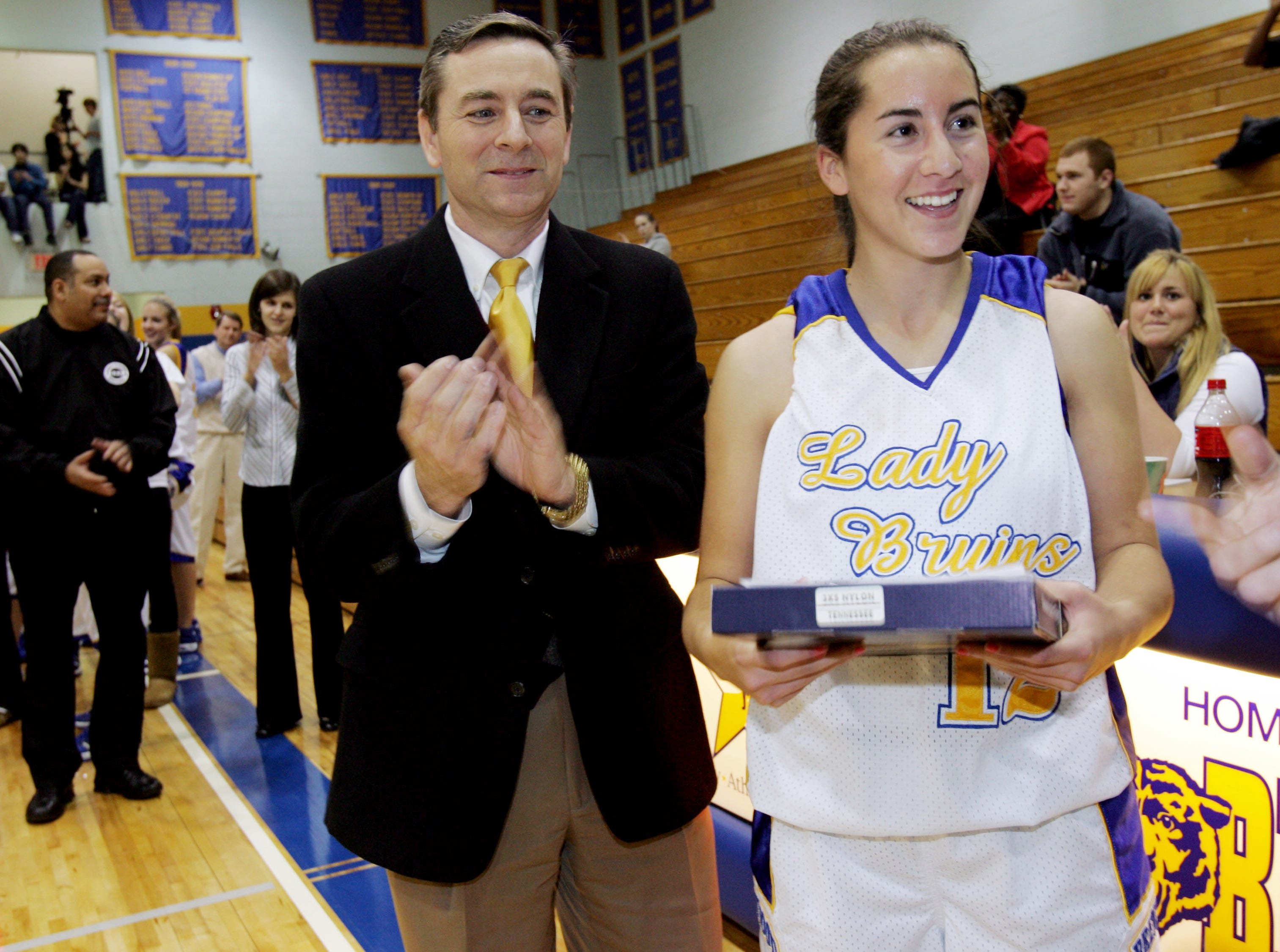 Dana Schwartz, right, of Brentwood High School accepts a state flag flown in her honor from Rep. Glenn Casada, left, and Sen. Jack Johnson (not shown) on Jan. 30, 2009. Schwartz was chosen to be part of the U.S. Soccer Team in the Maccabiah Games in Israel.