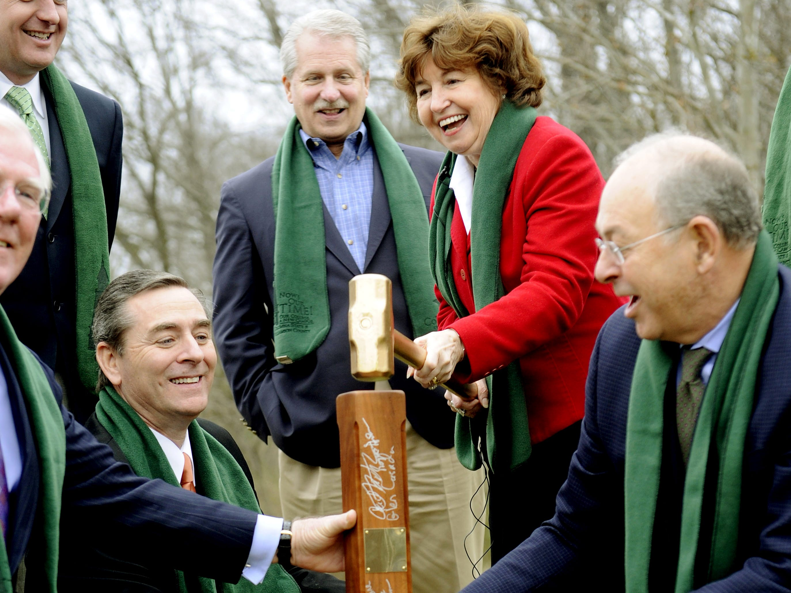 Columbia State Community College President Janet Smith drops the hammer on the fence post marking the college's new building site off Liberty Pike near Carothers Parkway on Jan. 20, 2012. Kneeling are state Reps. Charles Sargent, left, and Glen Casada and Franklin Mayor Ken Moore. Standing are state Sens. Jack Johnson and Bill Ketron.