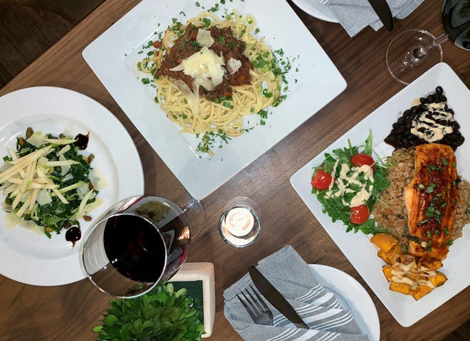 The Cafe on Fifth now has a seasonal dinner service featuring menu items such as, clockwise from left, a side of kale Brussels sprouts salad, grilled ancient grain glazed salmon and lamb shank ragout.