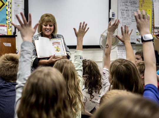 Sarah Danford smiles as her entire second-grade class raises hands to answer questions in May of 2018.