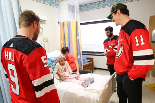 Brian Boyle, Taylor Hall and Kyle Palmieri spent the afternoon visiting with pediatric patients at Newark Beth Israel Medical Center & Children's Hospital of NJ. They are pictured here with Adriana Bonilla and her mom Roxana Nieto.