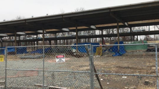 Only the frame of the future Motor Vehicle Commission office building in Wayne is standing so far. The dismissed general contractor says revisions are needed to make it serviceable for this Route 46 location.