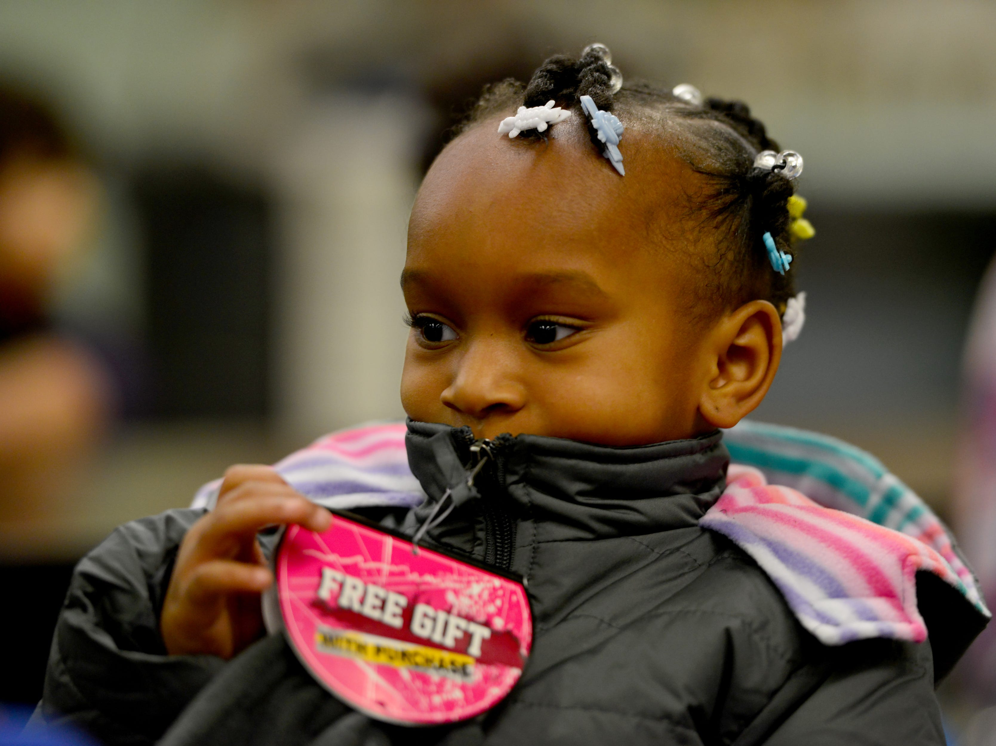 A'mor Leary, a PreK3 students, zips up her new coat. The Paterson Rotary held their eighth annual Christmas Coat Drive in Paterson, on Monday morning December 17, 2018. The club donated coats to all the students at Edward W. Kilpatrick Elementary School. The Rotary Club raised funds from its members and the community to buy 380 coats for the students.