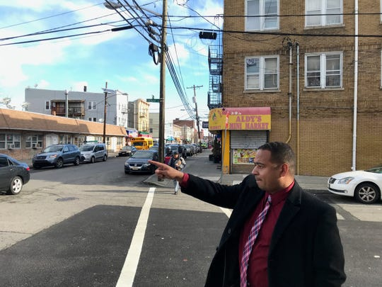 On Monroe Street Passaic Mayor Hector Lora shows where a boy who was recently shot when he left his home to get groceries lived on Lucille Place.