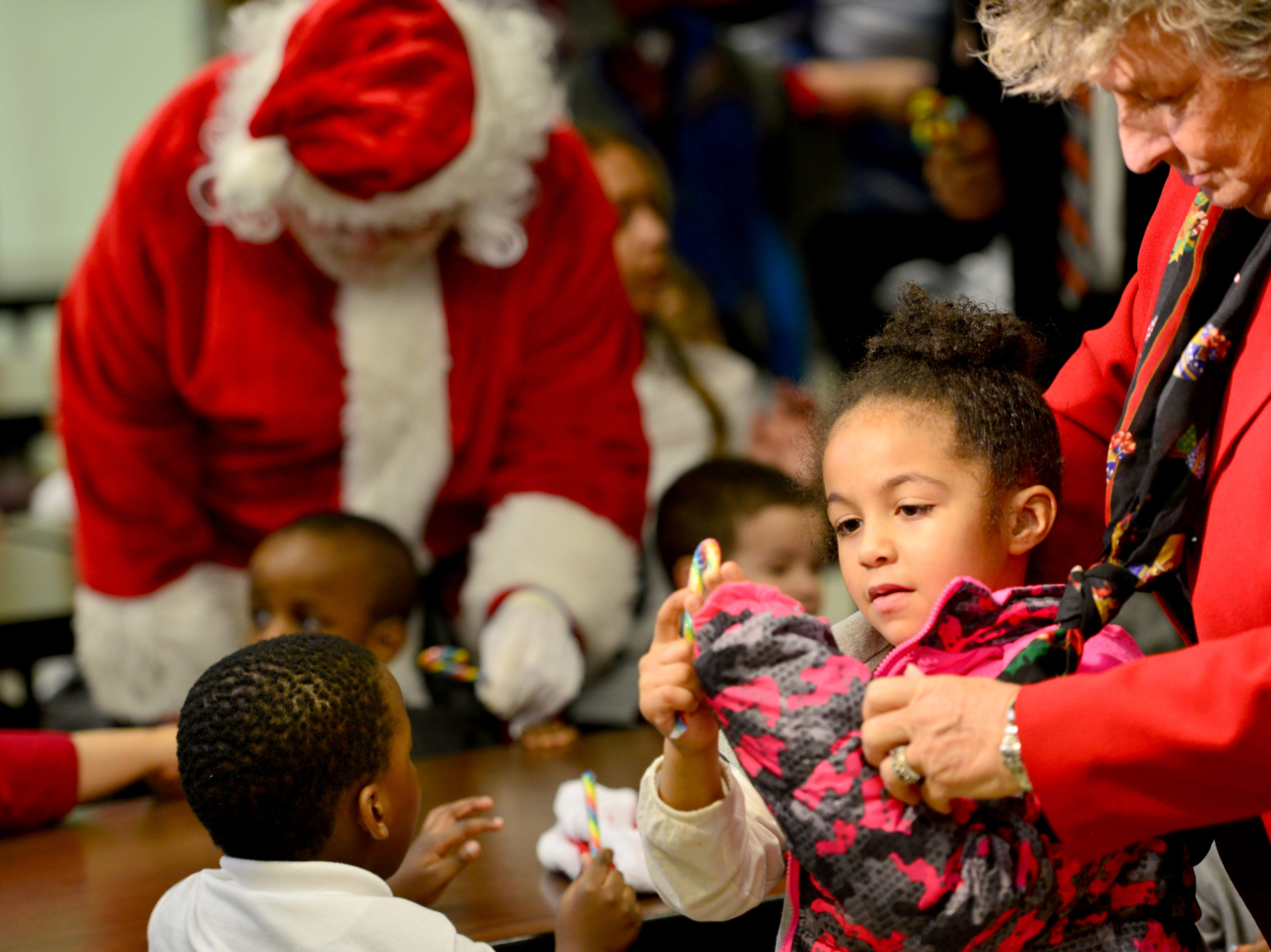 Paterson Schools Superintendent Eileen Shafer, helps Elliana Lusk, a PreK4 student put on her new coat. The Paterson Rotary held their eighth annual Christmas Coat Drive in Paterson, on Monday morning December 17, 2018. The club donated coats to all the students at Edward W. Kilpatrick Elementary School. The Rotary Club raised funds from its members and the community to buy 380 coats for the students.
