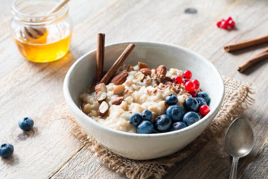 Oatmeal Porridge Bowl With Fruits Nuts And Cinnamon In Bowl