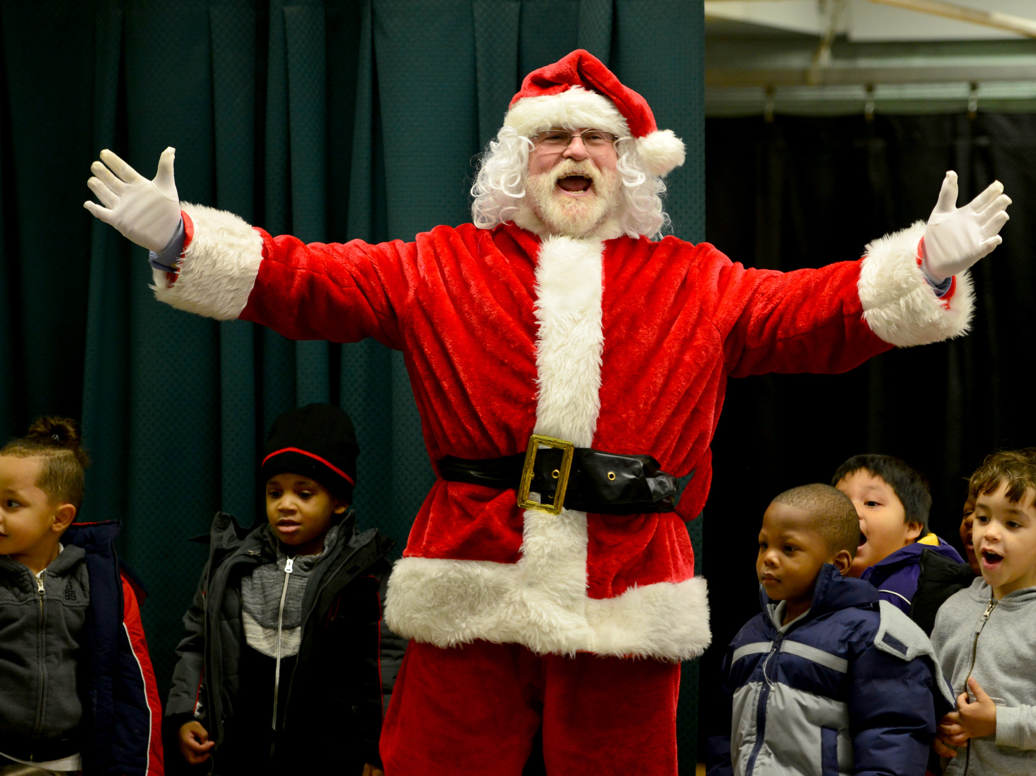 Jamie Dyke, a member of the Rotary dressed as Santa Claus, wishes the students a Merry Christmas. The Paterson Rotary held their eighth annual Christmas Coat Drive in Paterson, on Monday morning December 17, 2018. The club donated coats to all the students at Edward W. Kilpatrick Elementary School. The Rotary Club raised funds from its members and the community to buy 380 coats for the students.