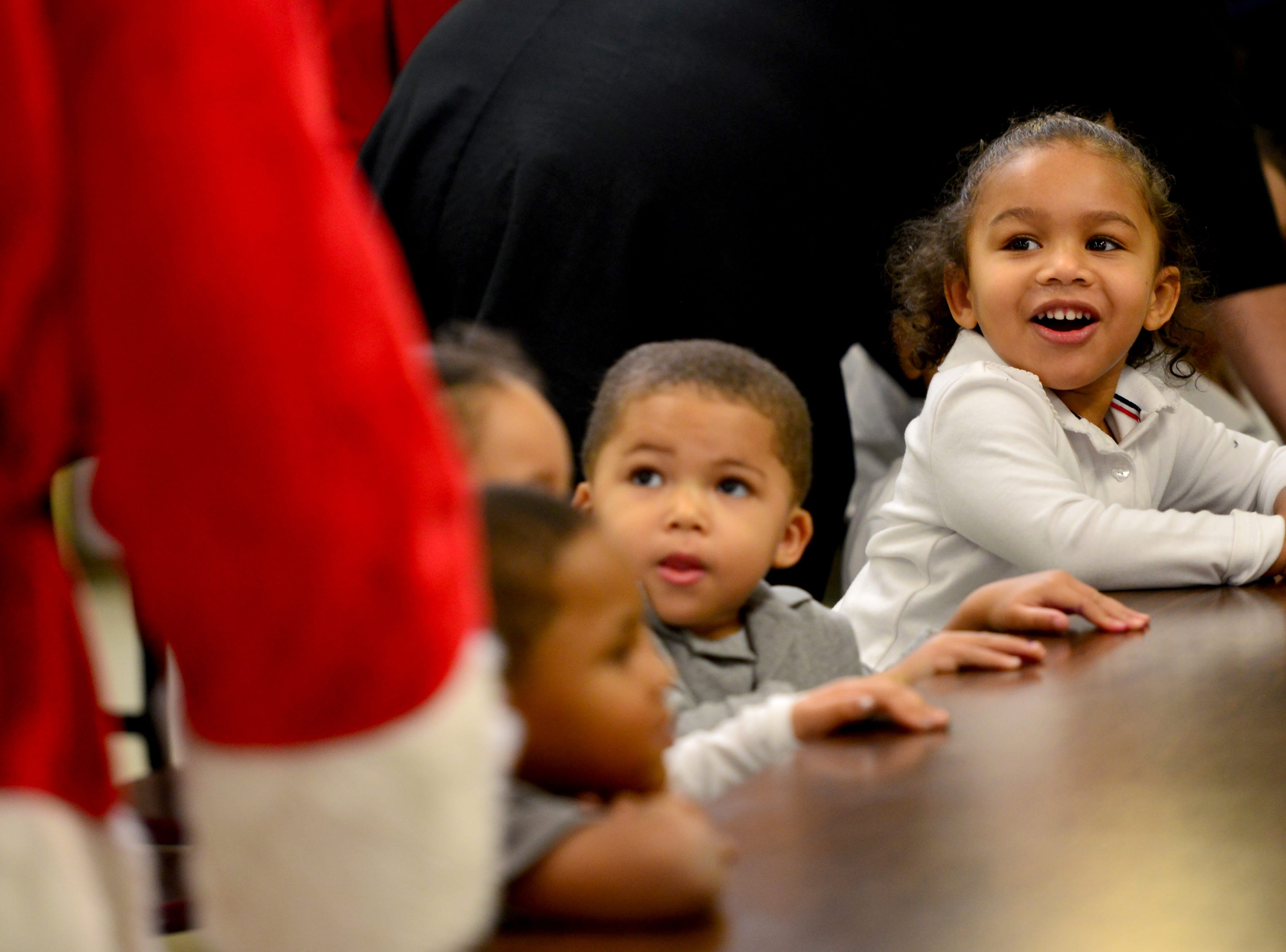 Children smile as they look up at Jamie Dyke, a member of the Rotary, dressed as Santa Claus. The Paterson Rotary held their eighth annual Christmas Coat Drive in Paterson, on Monday morning December 17, 2018. The club donated coats to all the students at Edward W. Kilpatrick Elementary School. The Rotary Club raised funds from its members and the community to buy 380 coats for the students.