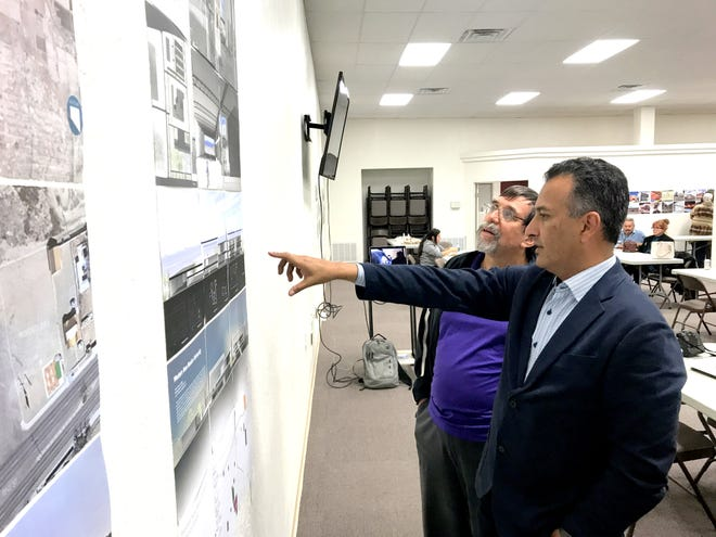 At right, UNM Associate Dean Tim Castillo discusses conceptual plans for Western New Mexico University-Deming with Ken Leupold, branch director.