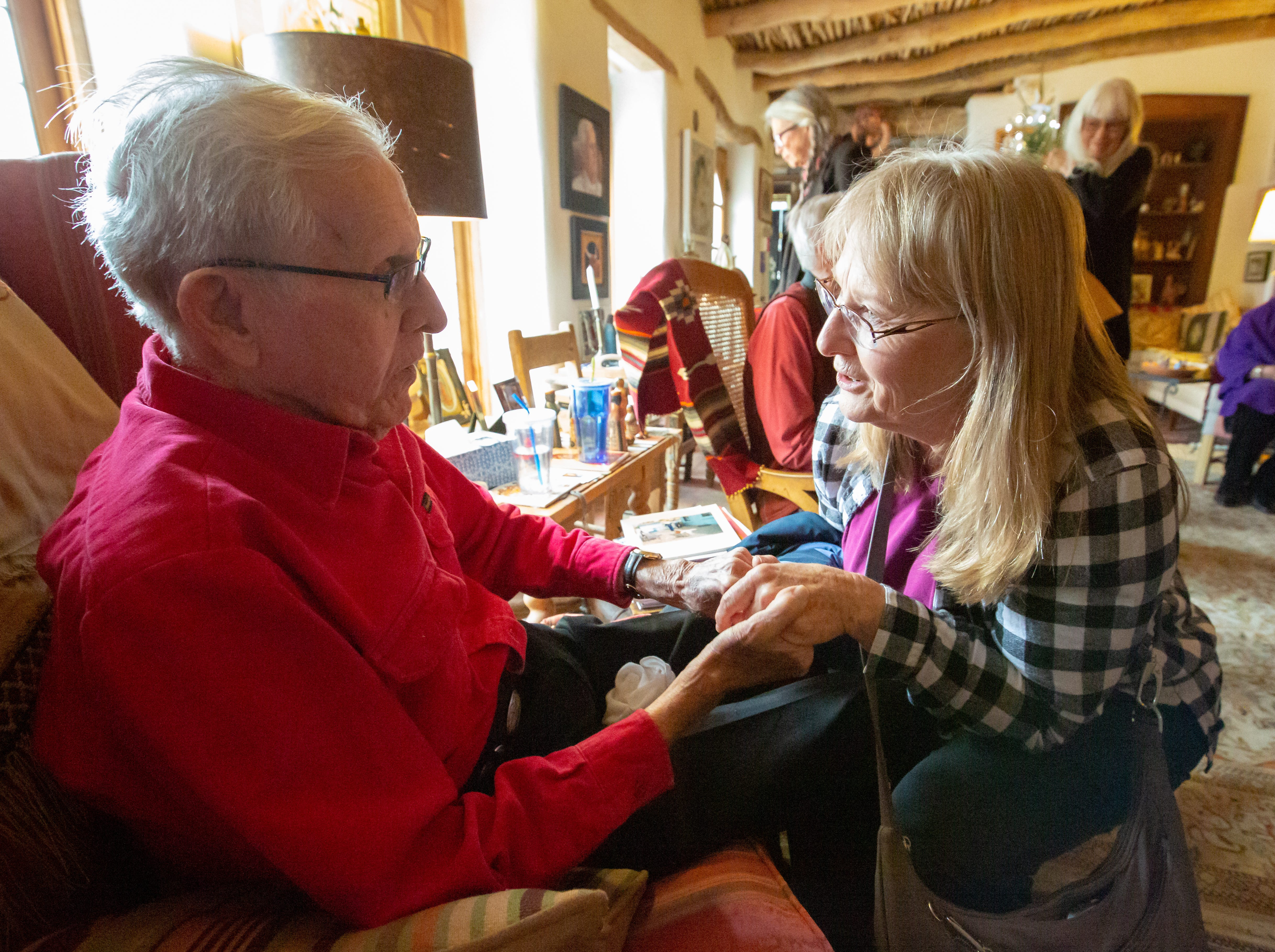 J. Paul Taylor is visited by Mary Andrews, of Las Cruces, on Sunday, December 16, 2018, during Nacimiento Open House with J. Paul Taylor at the Taylor-Barela-Reynolds-Mesilla Historic Site located in the Mesilla Plaza. Over 175 nacimientos (nativity scenes) were on display from around the world.