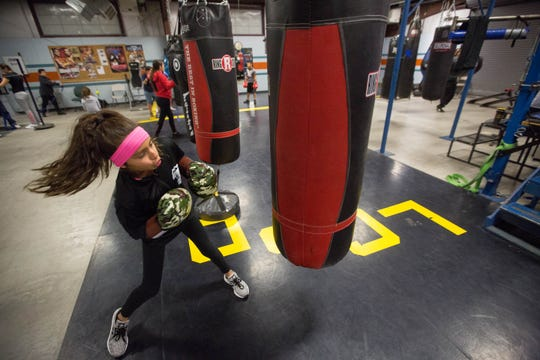 Joscelyn Olayo-Muñoz, 11, also known as Jos the Boss, demonstrates some of her boxing skills at the Doña Ana Boxing Club on Monday December 10, 2018.