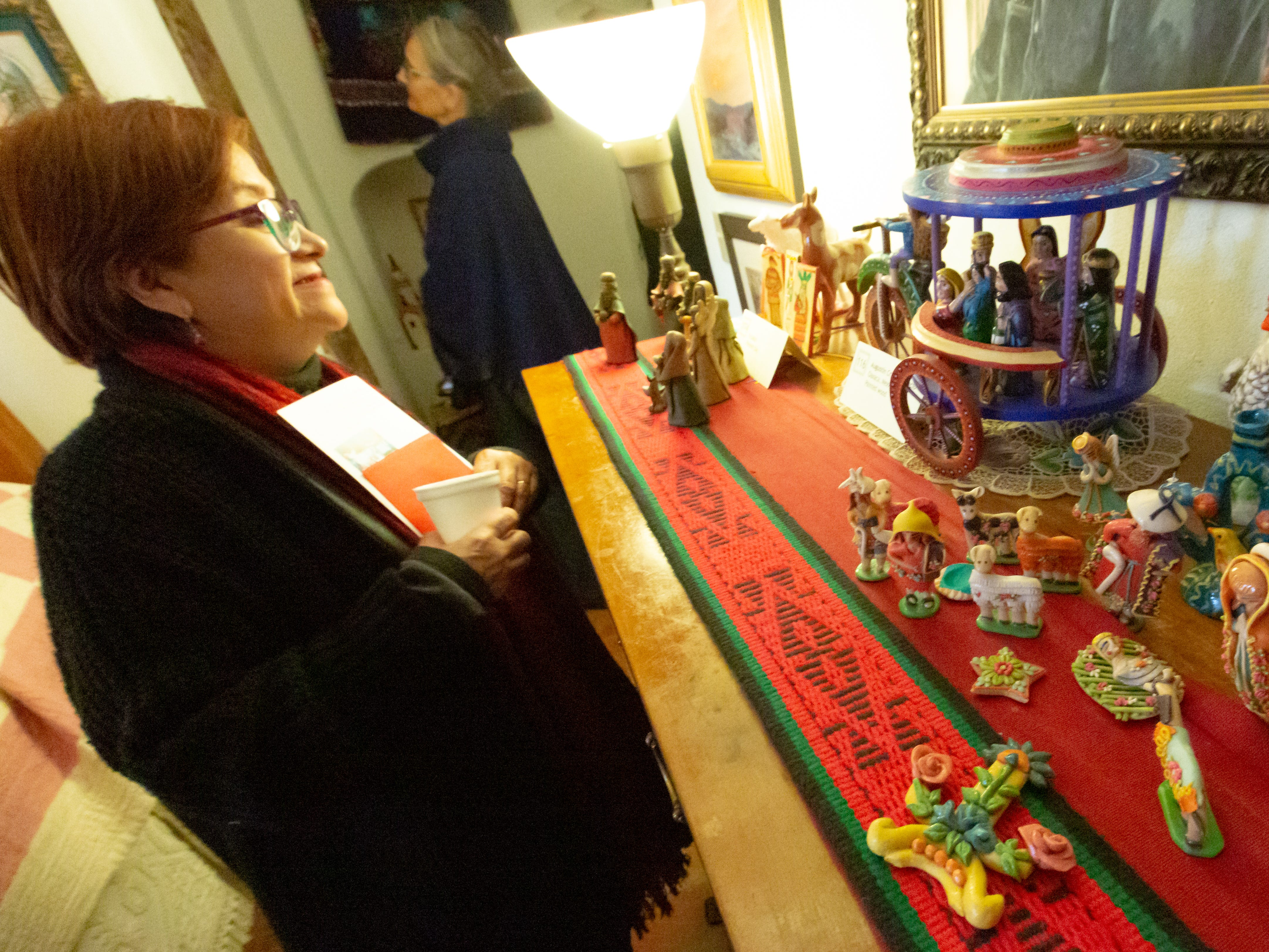 Gloria Burciaga looks at nativity scenes on Sunday, December 16, 2018, during Nacimiento Open House with J. Paul Taylor at the Taylor-Barela-Reynolds-Mesilla Historic Site located in the Mesilla Plaza.