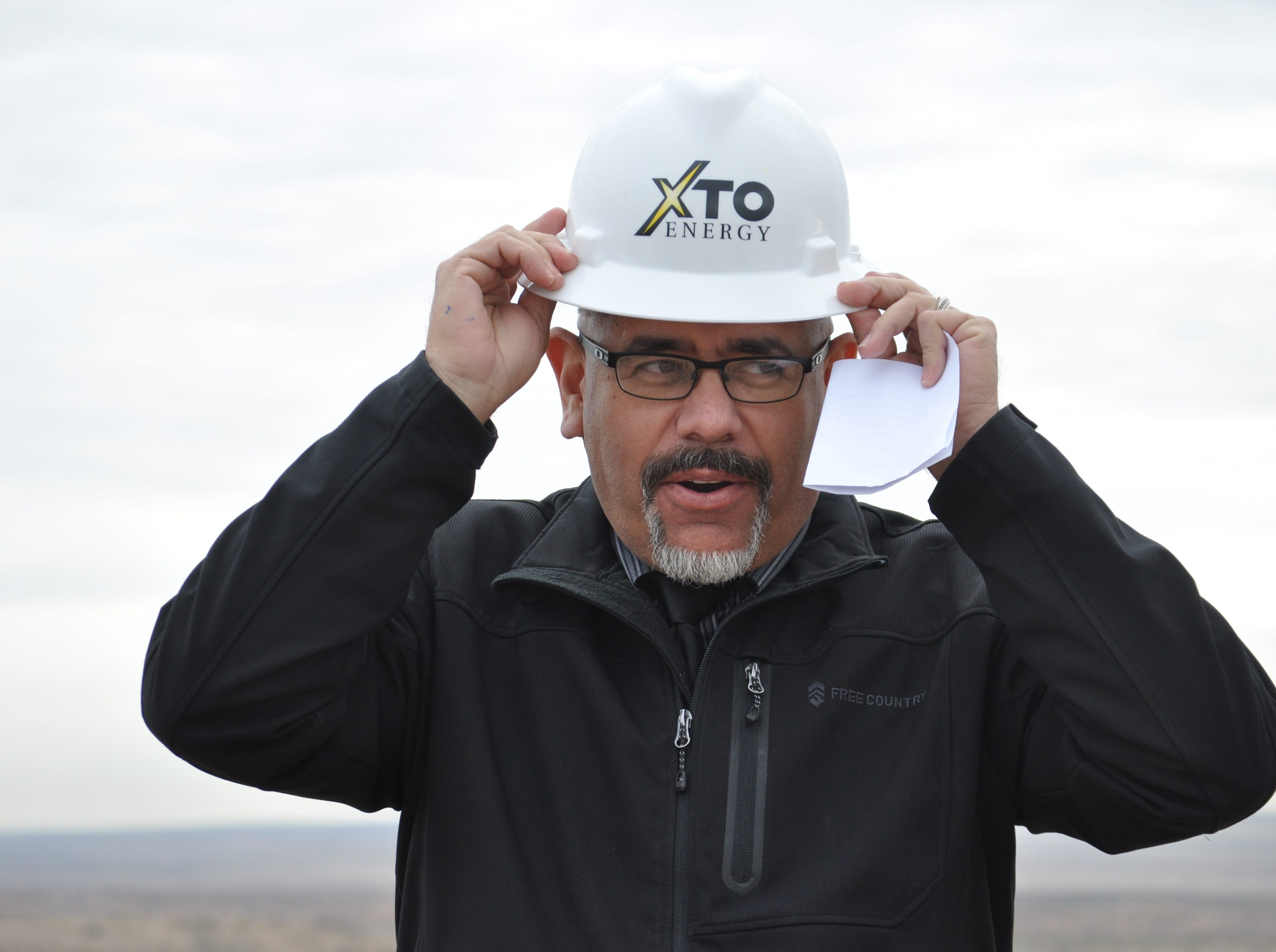 Carlsbad City Manager Mike Hernandez dons a hard hat Dec. 17 ahead of the ground breaking on a $12 million investment by the city and XTO Energy to build at 5 million gallon water tank and disinfection facility near Carlsbad, New Mexico.