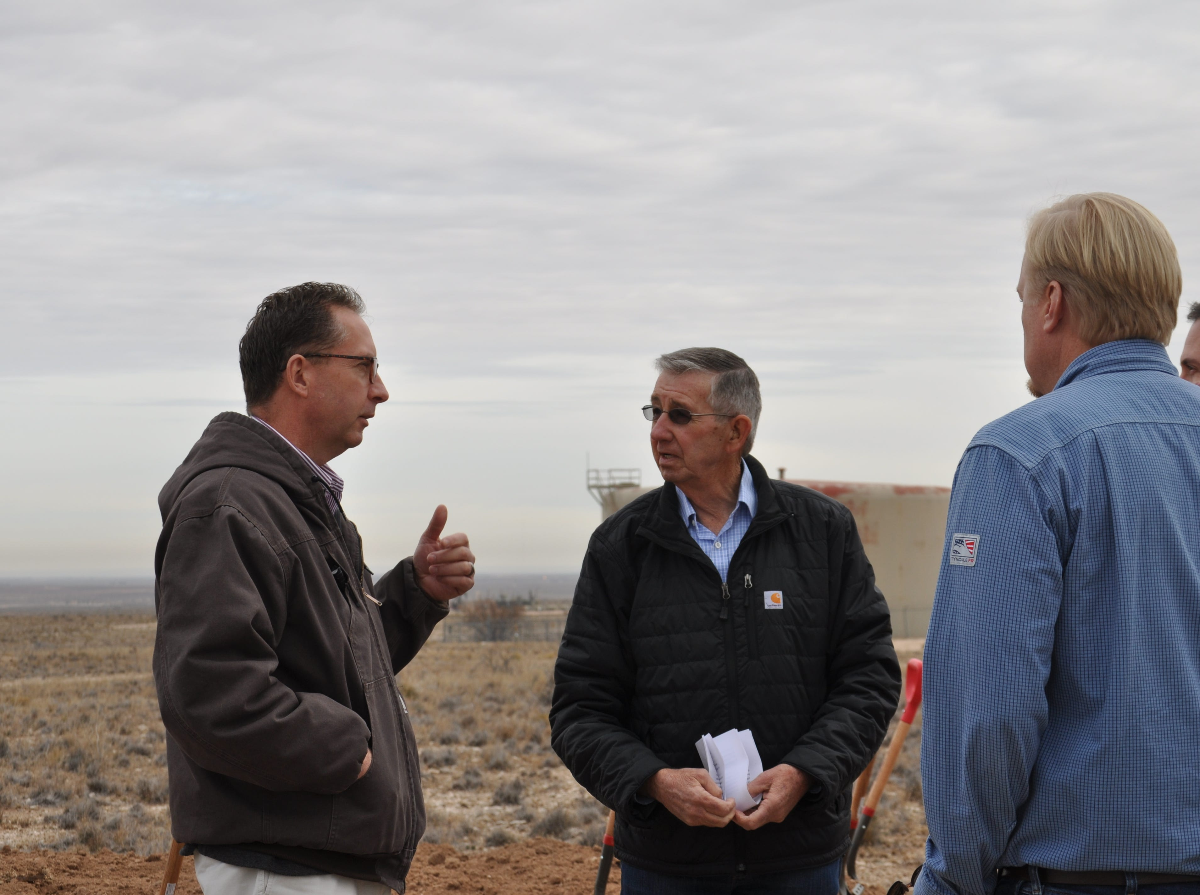 Carlsbad Mayor Dale Janway, center, Dec. 17 at the site of the Double Eagle Phase 3 project  in Carlsbad, New Mexico.