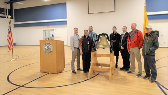 The bell has been returned back to the school district during an unveiling this month. In attendance were (from left to right) School board Vice President Marc Beatty, board members Gina Klinekole and Shane Holder, Secretary Gillian Baudo, Superintendent Dr. George Bickert, President Luther Light, and Frank Potter.