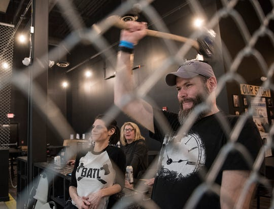 Chain link fencing keeps the ax throwing safer.