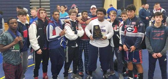 Westland John Glenn's wrestling team captured its sixth straight Wayne County Championship on Dec. 15 at Wyandotte.