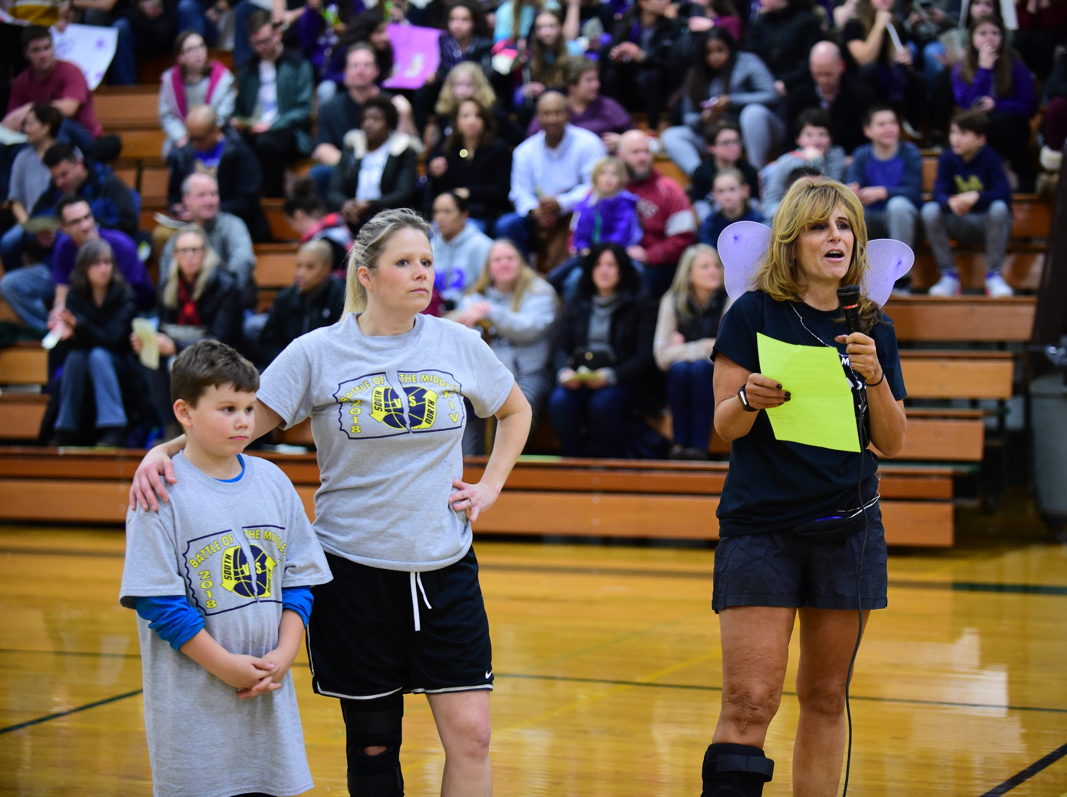 "Event coordinators, Whitney Tyner (with her son, Teague) Kathy Koperski kickoff the start of the ""Battle of the Middles."""
