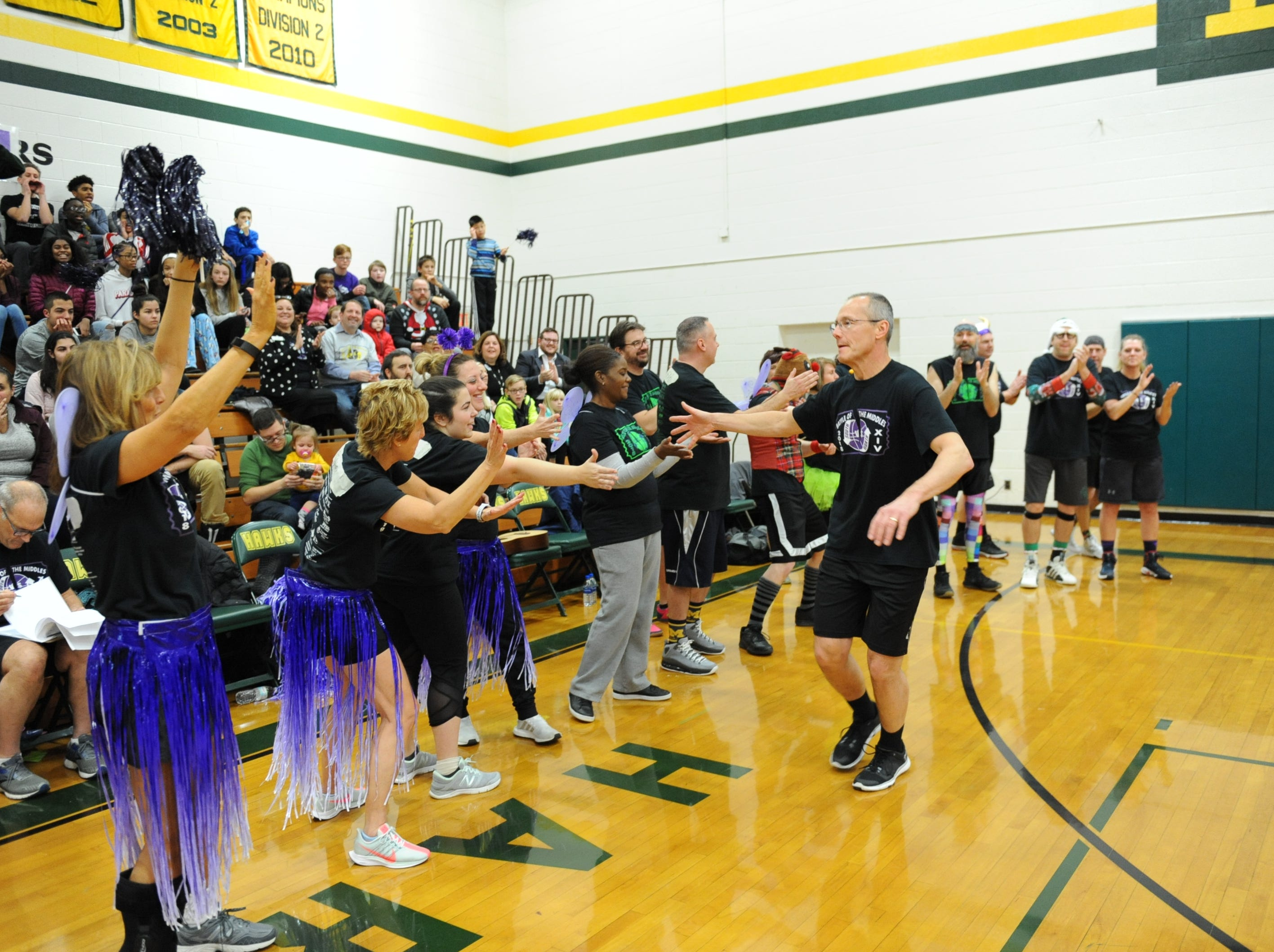 Tom Moss (Warner) has team spirit during the charity basketball game.