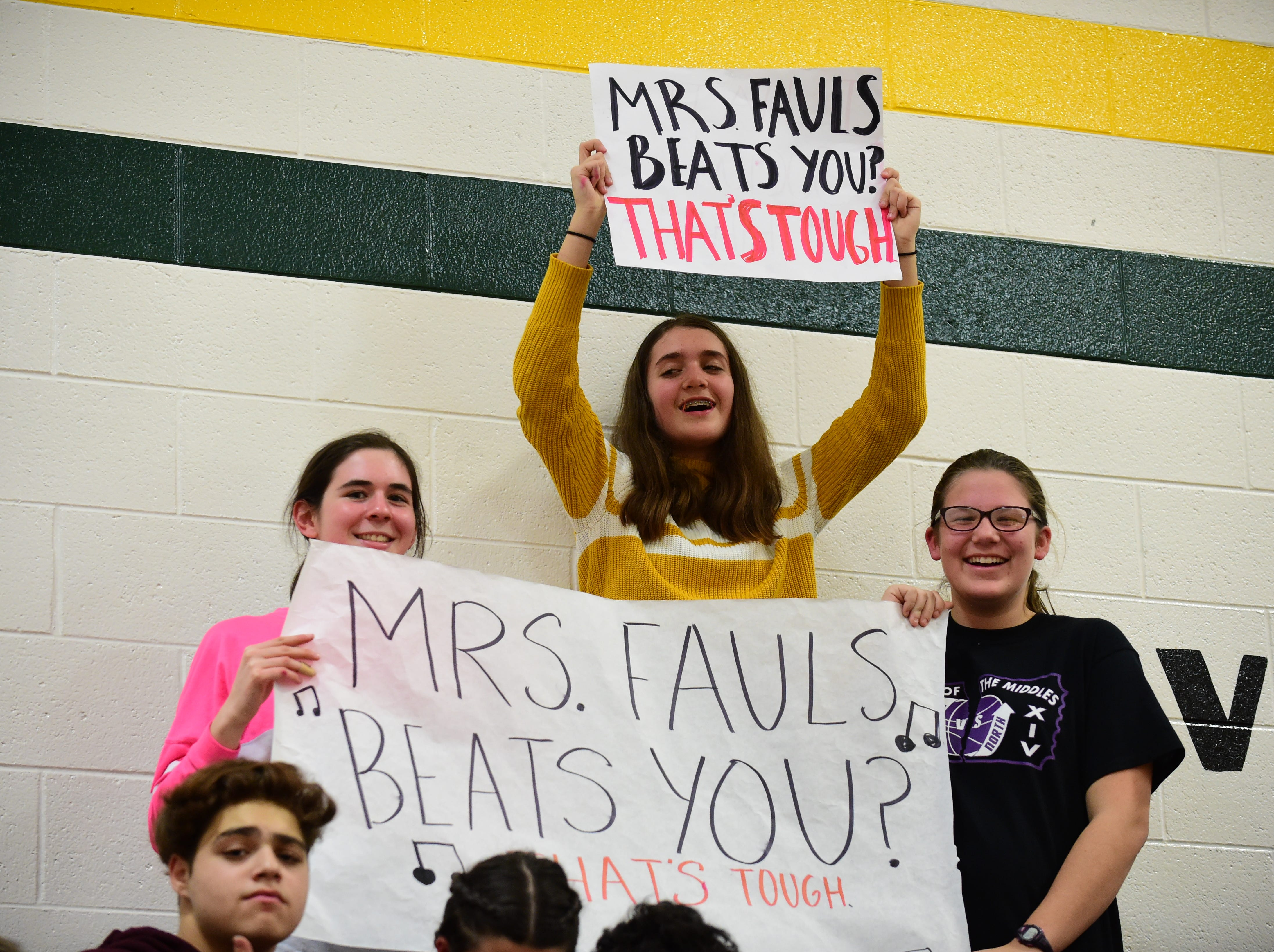 Warner Middle School students cheer for their favorite teacher.