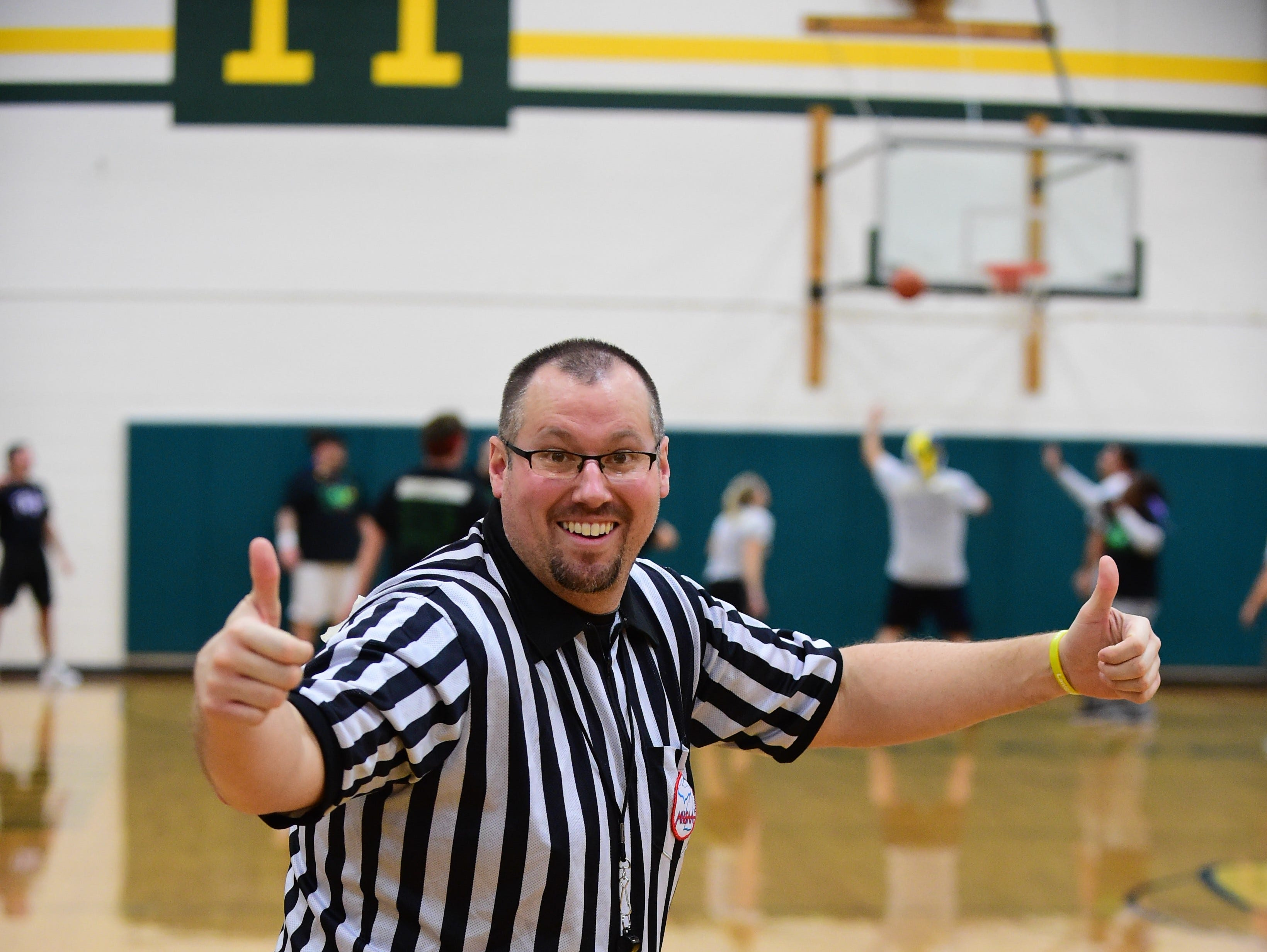Andy Lamott (Hillside Elementary) poses as he referees the basketball charity game.