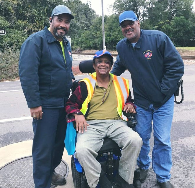 City of Pensacola employees Gary Tucker and George Smith Jr. helped a man whose wheelchair wheels were stuck in the train tracks off East Maxwell Street in Pensacola.
