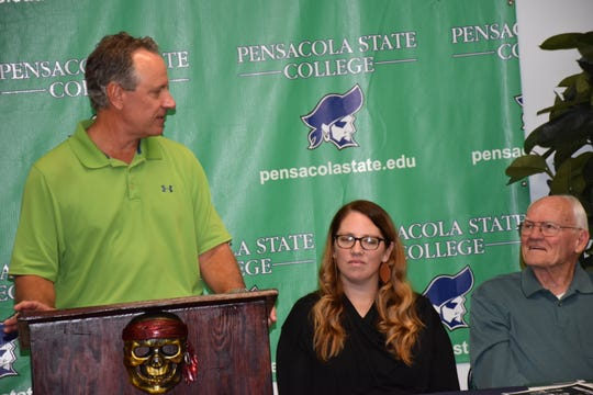 Pensacola's Greg Litton speaks about his announcement Monday into the inaugural class of the Pensacola State College Athletic Hall of Fame as fellow inductees Dana Gilmore and Bill Brantley look on.