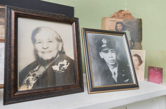 "A photo of James Polkinghorne in uniform is displayed on the mantle in the home of Maggie Wilson in Pensacola on Monday. A new book titled ""Lost in Heaven"" tells the story of her brother, James Polkinghorne, a Tuskegee Airman, who lost his life during World War II."