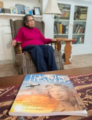 """Maggie Wilson talks Monday about the book """"Lost in Heaven"""" at her home in Pensacola. The book tells the story of her brother, James Polkinghorne, a Tuskegee Airman, who lost his life during World War II."""