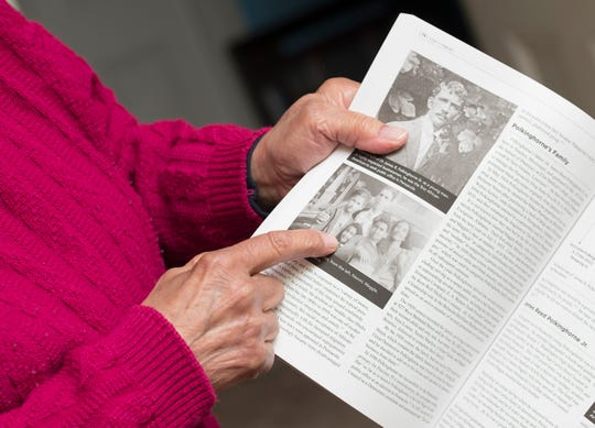 """Maggie Wilson points to herself in a photo in the book """"Lost in Heaven"""" at her home in Pensacola on Monday. The book tells the story of her brother, James Polkinghorne, a Tuskegee Airman, who lost his life during World War II."""