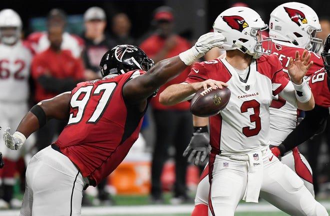 Atlanta Falcons defensive tackle Grady Jarrett (97) prepares to cause a fumble against Arizona Cardinals quarterback Josh Rosen (3) during the first half of an NFL football game, Sunday, Dec. 16, 2018, in Atlanta.