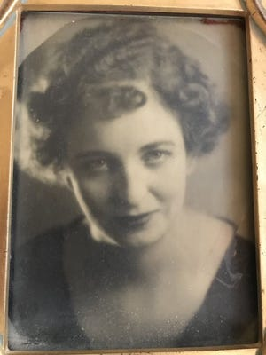 Faith Morrow, adoptive mother of Sharon Elliott, in her 20s.
