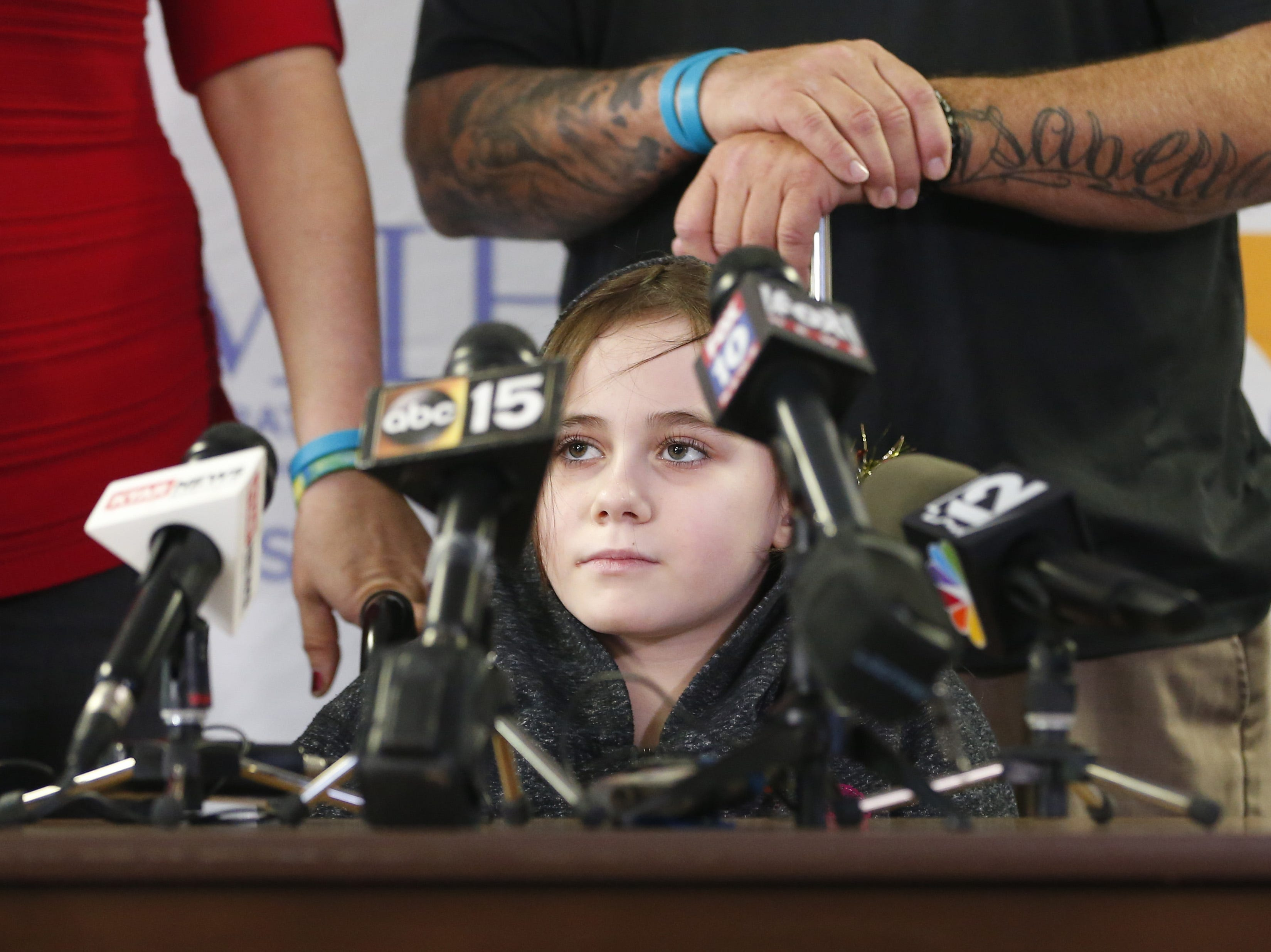 Isabella McCune answers questions during a press conference at the Arizona Burn Center in Phoenix on Dec. 17, 2018. The 9-year-old was discharged nine months to the day after she was severely burned in a home accident.